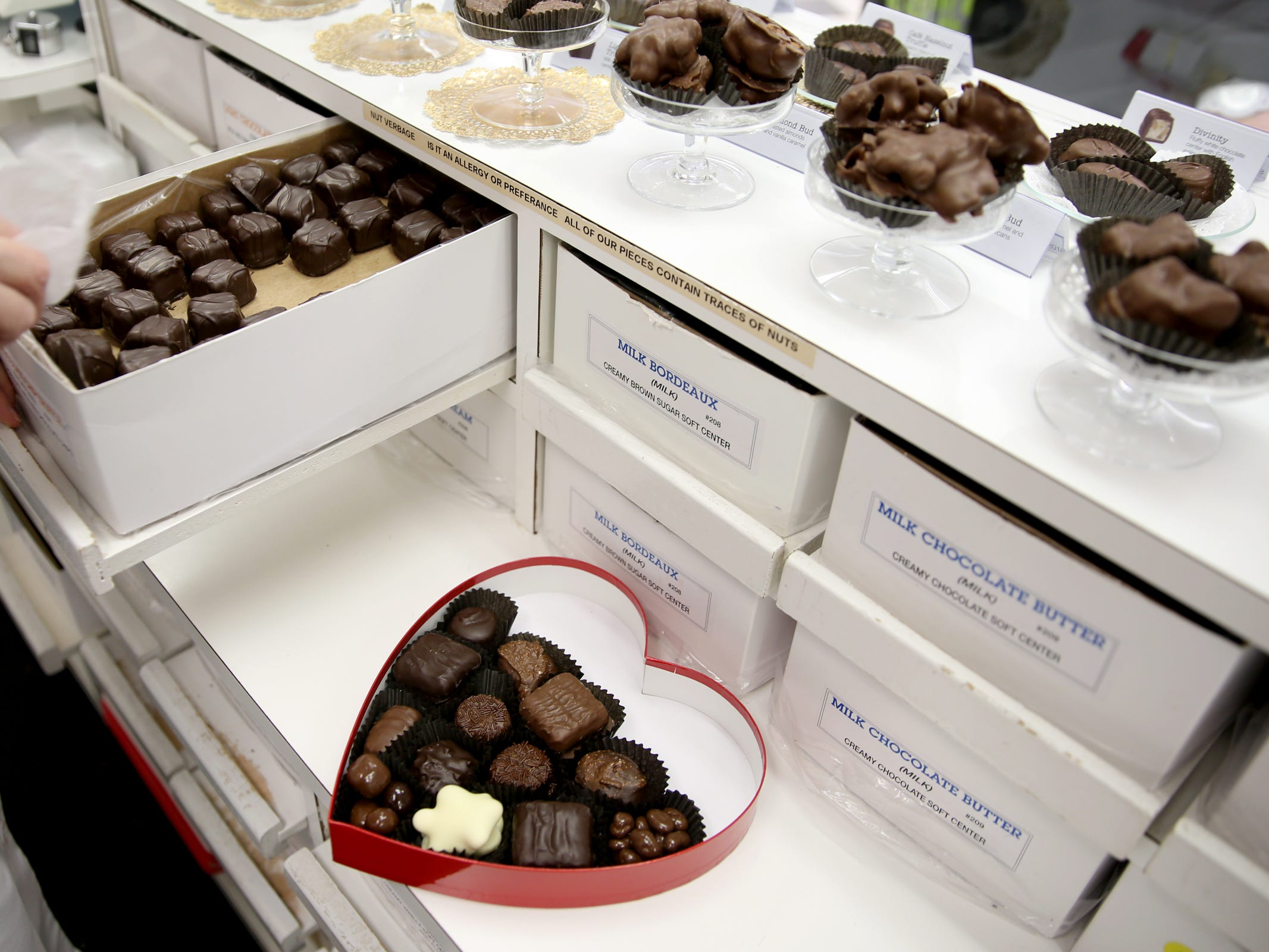 Robyn Skog, the store assistant manager, builds a custom heart-shaped box of chocolates at See's Candies in downtown Salem on Tuesday, Feb. 5, 2019.