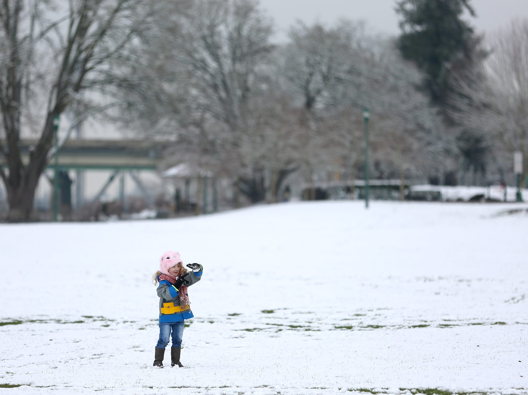 Liliana Johnson, 4, plays in the snow at Riverfront Park in Salem on Tuesday, Feb. 5, 2019.