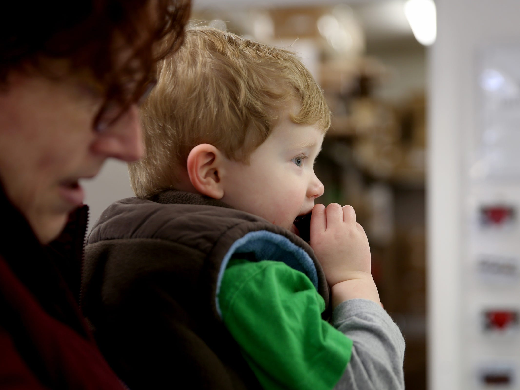 C.J. Wells, 2, of Salem, nibbles on a free sample at See's Candies in downtown Salem on Tuesday, Feb. 5, 2019.