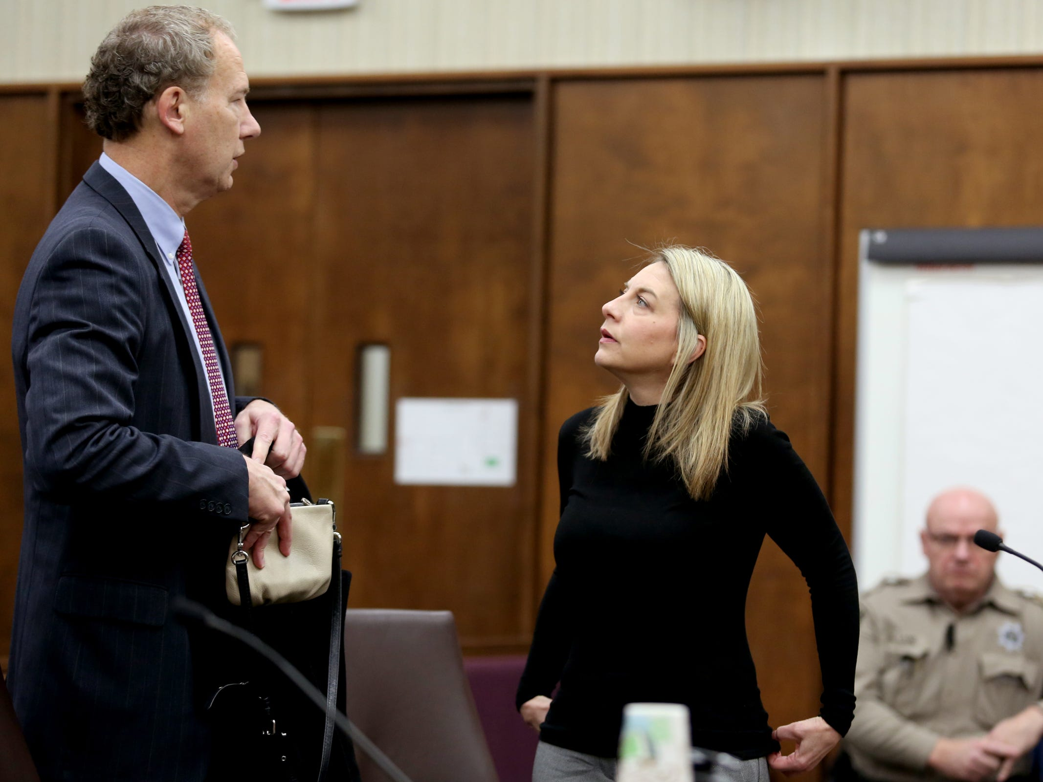 Jennifer Weathers speaks with her attorney, Walter Todd, before entering a guilty plea for driving under the influence on the night of her daughter's death in 2018 at the Yamhill County Courthouse in McMinnville on Tuesday, Feb. 5, 2019. Meighan Cordie died from blunt force trauma after jumping or falling out of the car her mother was driving while her 3-year-old daughter was also in the vehicle.