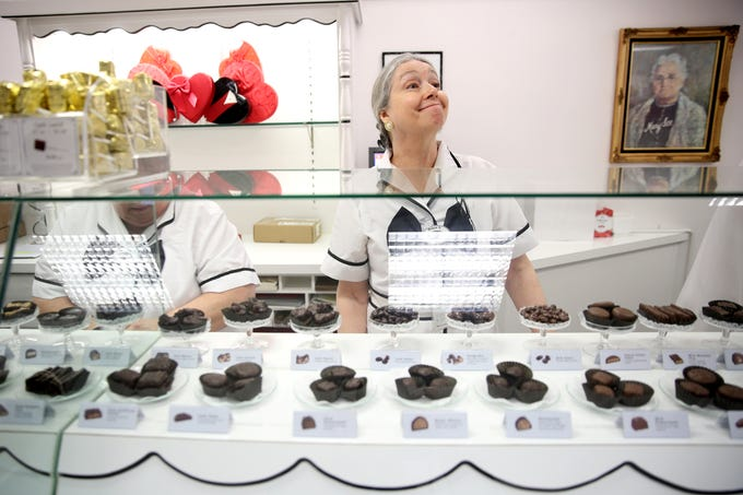 Robyn Skog, the store assistant manager, helps a customer at See's Candies in downtown Salem on Tuesday, Feb. 5, 2019.