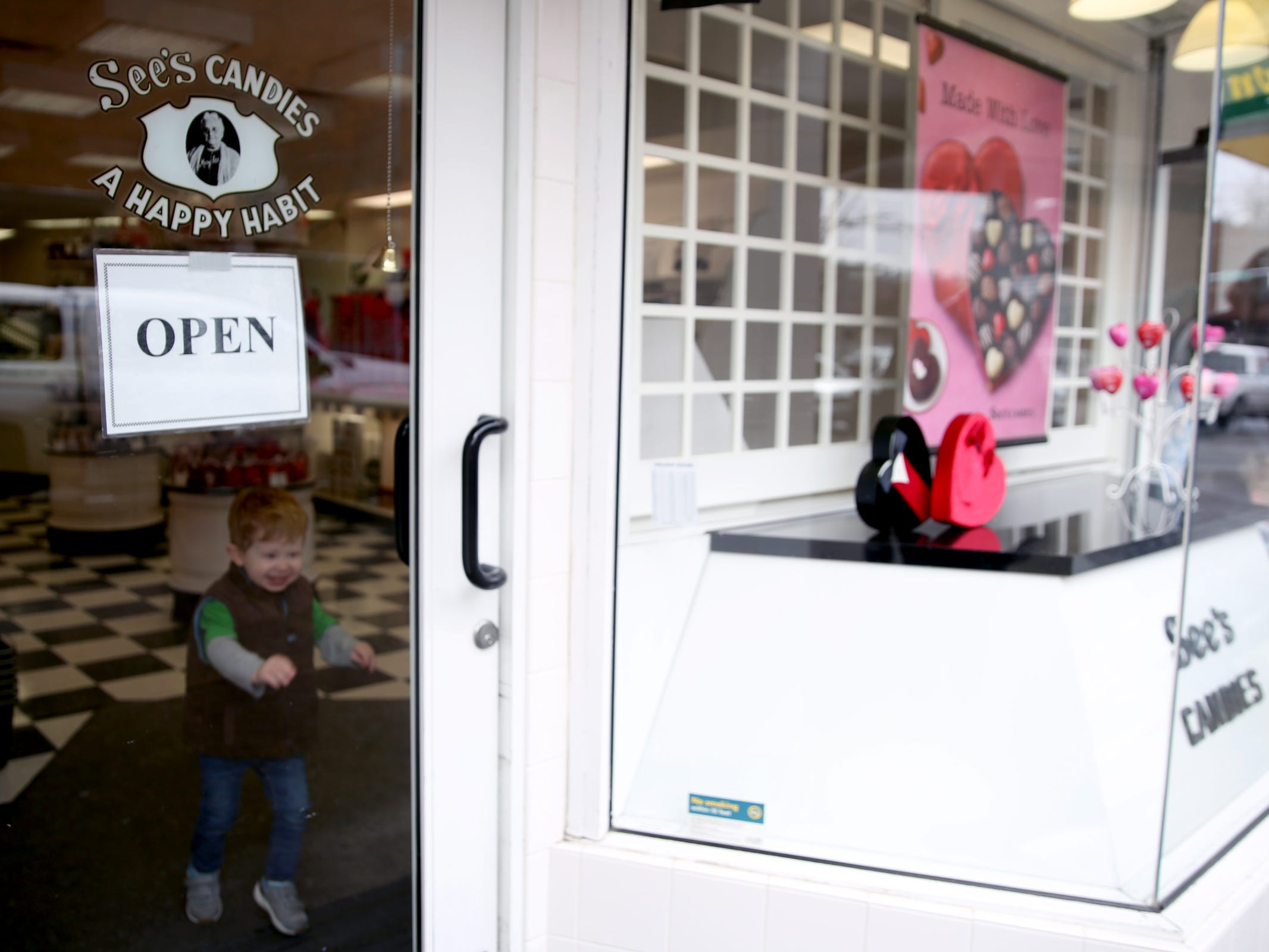 C.J. Wells, 2, of Salem, visits See's Candies in downtown Salem on Tuesday, Feb. 5, 2019.