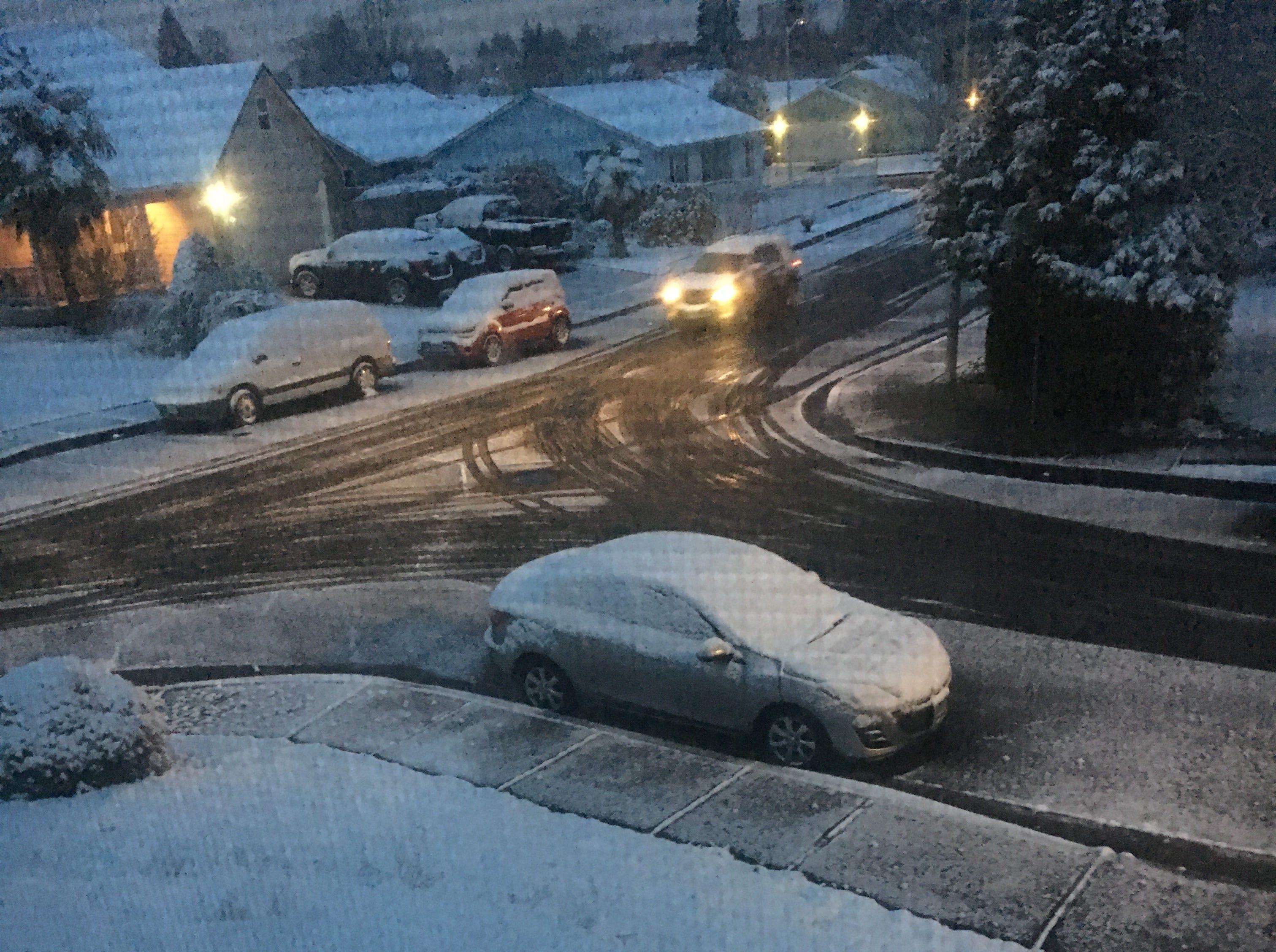 Snow blankets a northeast Salem neighborhood early Tuesday.