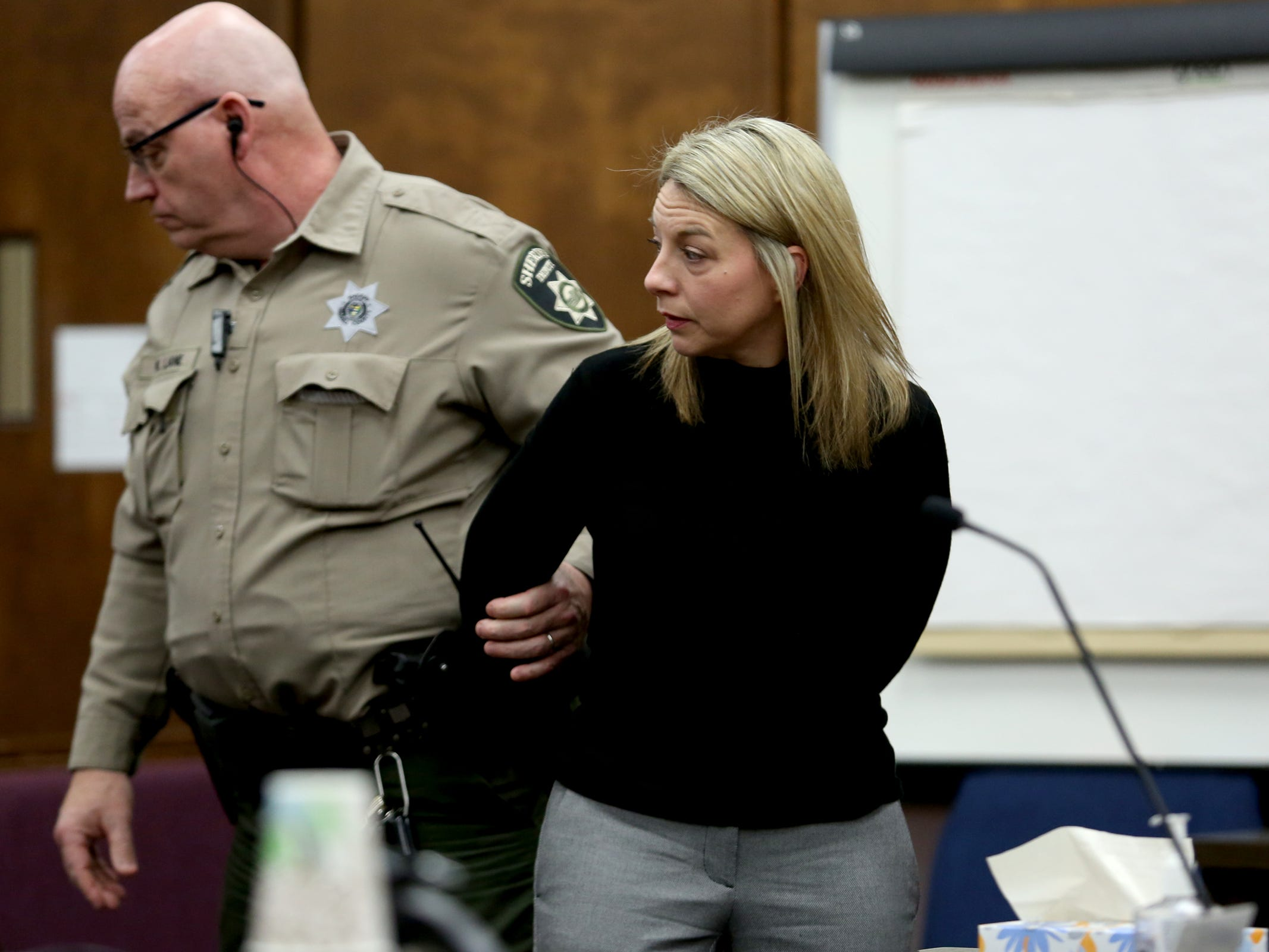 Jennifer Weathers is taken away in handcuffs by a Sheriff's deputy after entering a guilty plea for driving under the influence on the night of her daughter's death in 2018 at the Yamhill County Courthouse in McMinnville on Tuesday, Feb. 5, 2019. Meighan Cordie died from blunt force trauma after jumping or falling out of the car her mother was driving while her 3-year-old daughter was also in the vehicle.