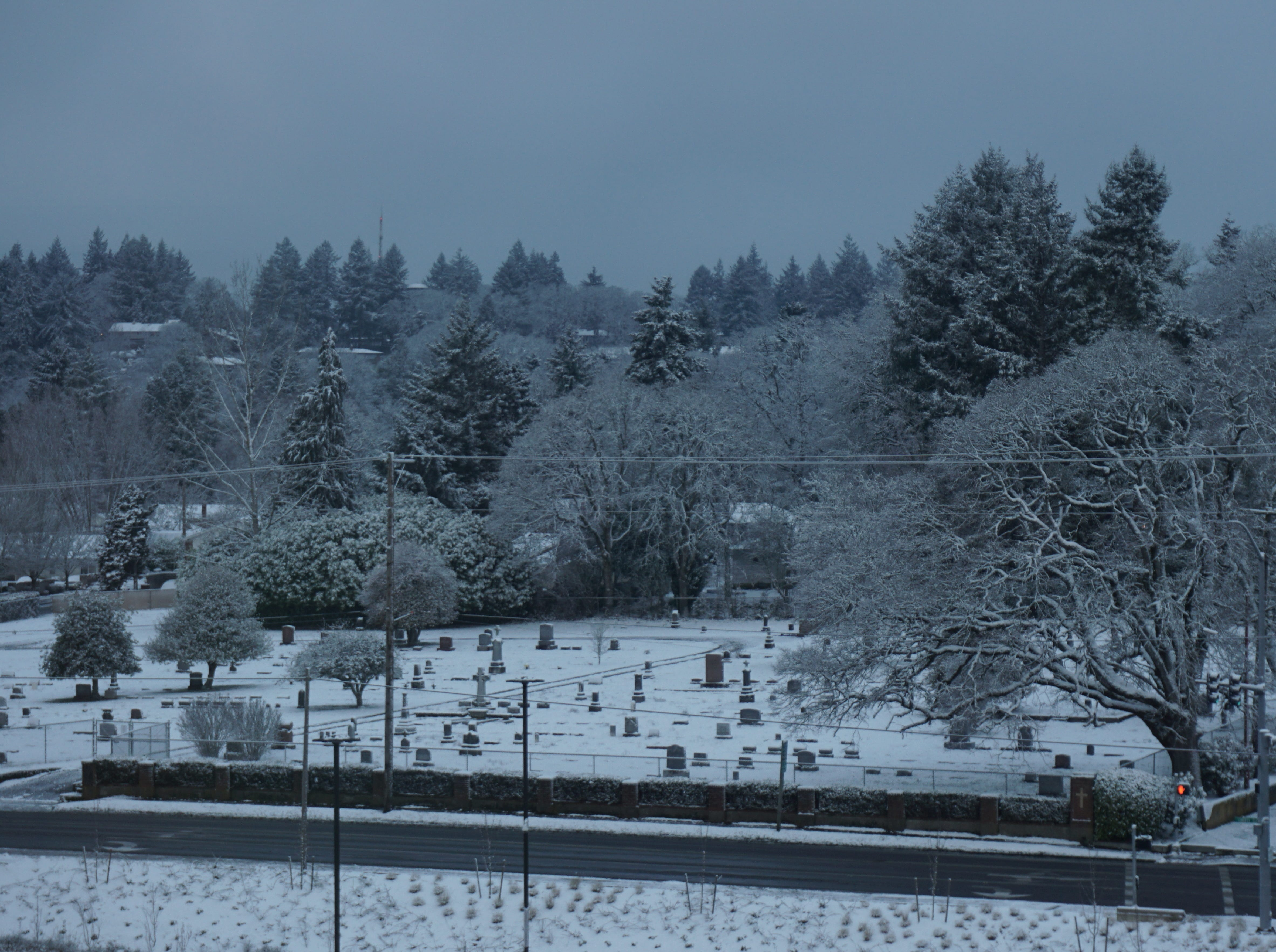 Snow-covered St. Barbara Cemetery on Liberty Road S as seen early Tuesday morning from the Statesman Journal office.