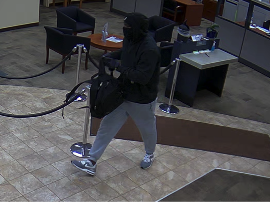 Authorities are asking for the public's help identifying an armed suspect who robbed Columbia Bank branch in Salem Friday.