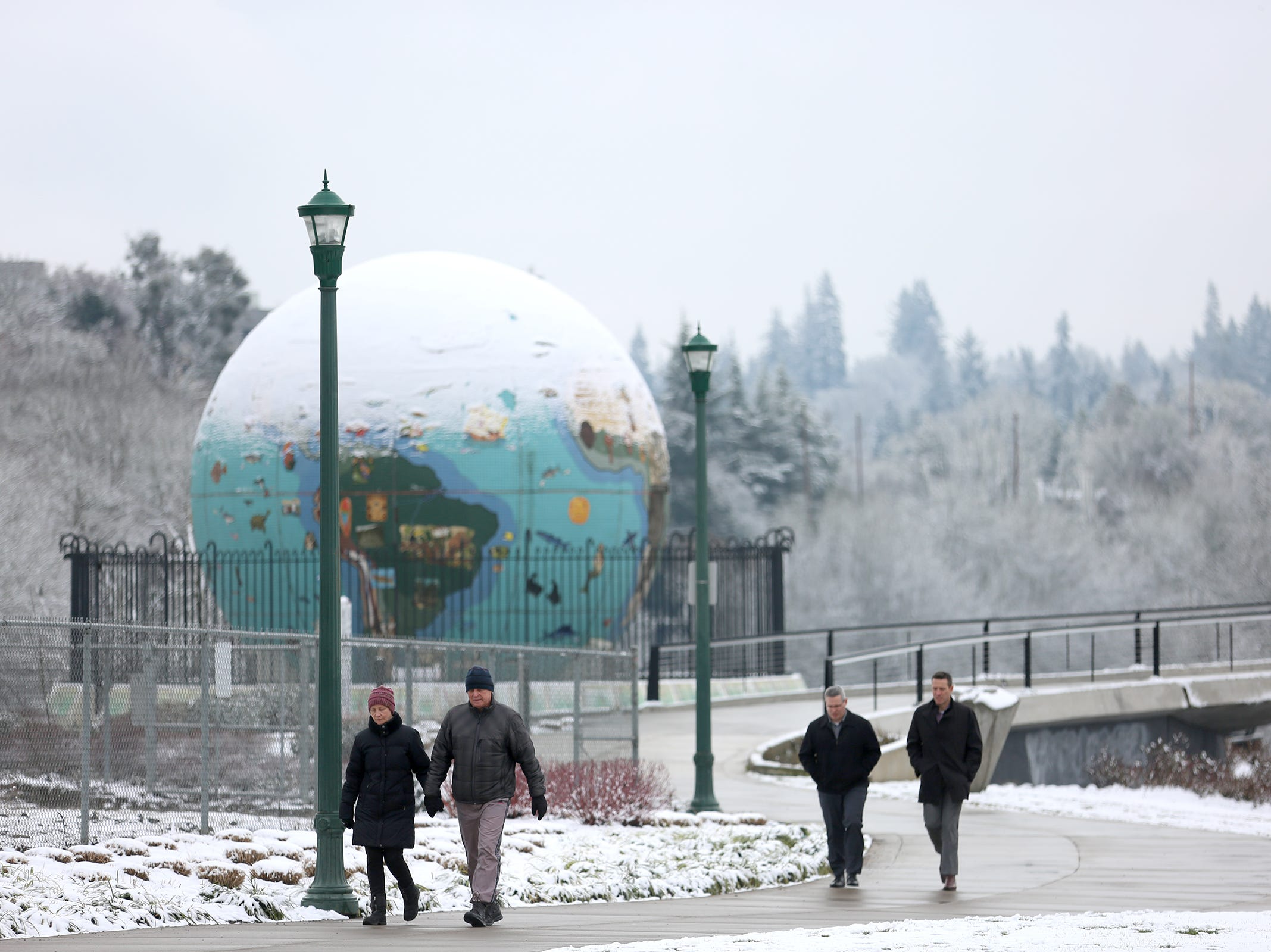 People go for a walk at Riverfront Park in Salem after it snowed on Tuesday, Feb. 5, 2019.
