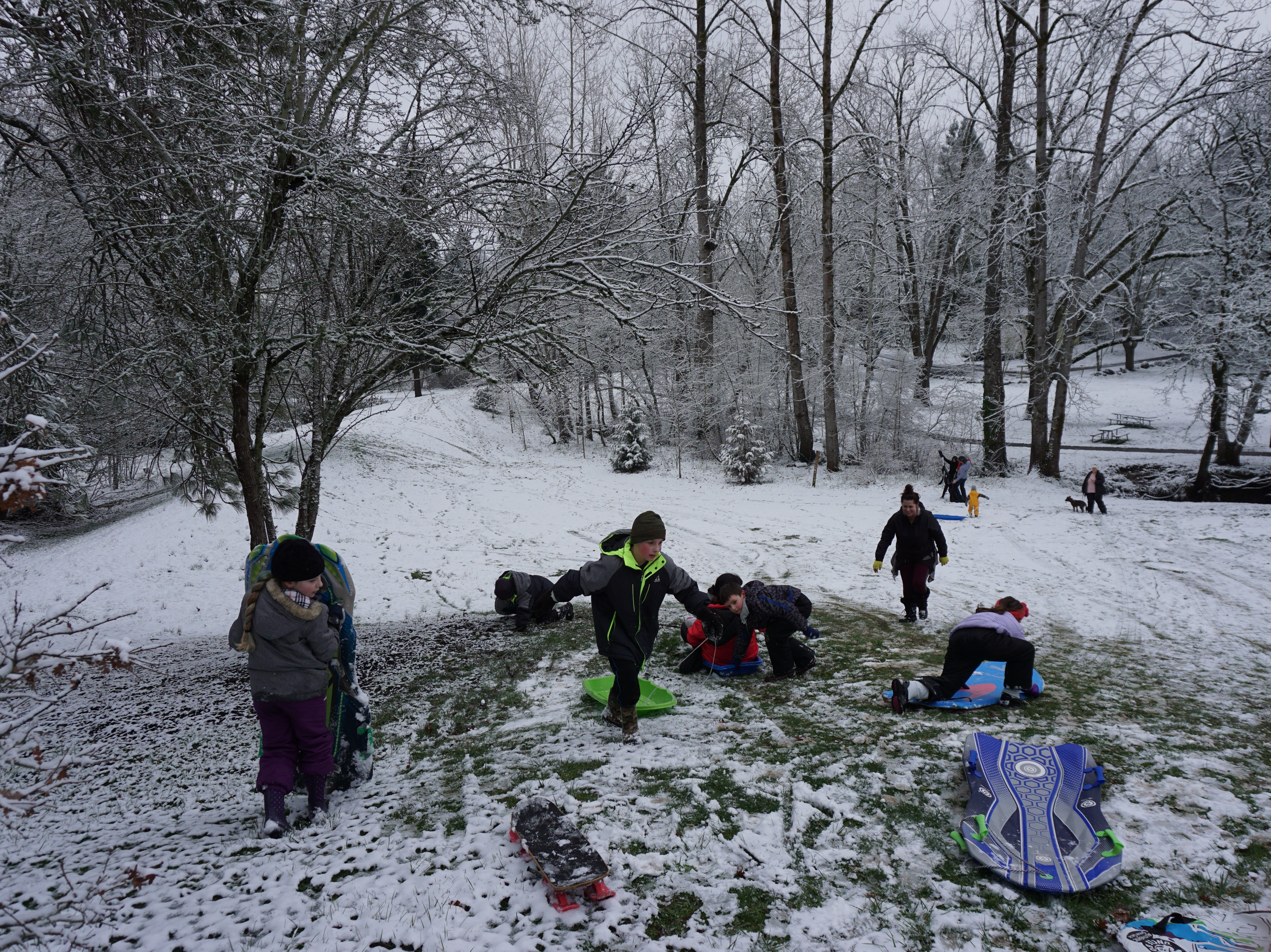 With school cancelled in Salem-Keizer because of the snow, young sledders descend the hills on Tuesday, Feb. 5, 2019, at Clark Creek Park in Southeast Salem.