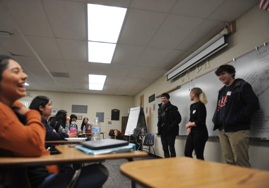 At the front of the class from left to right, French students Yann Van Breenen, Claryce Hurtel and Louis Verhague field questions from Everett Alvarez High School French language students.