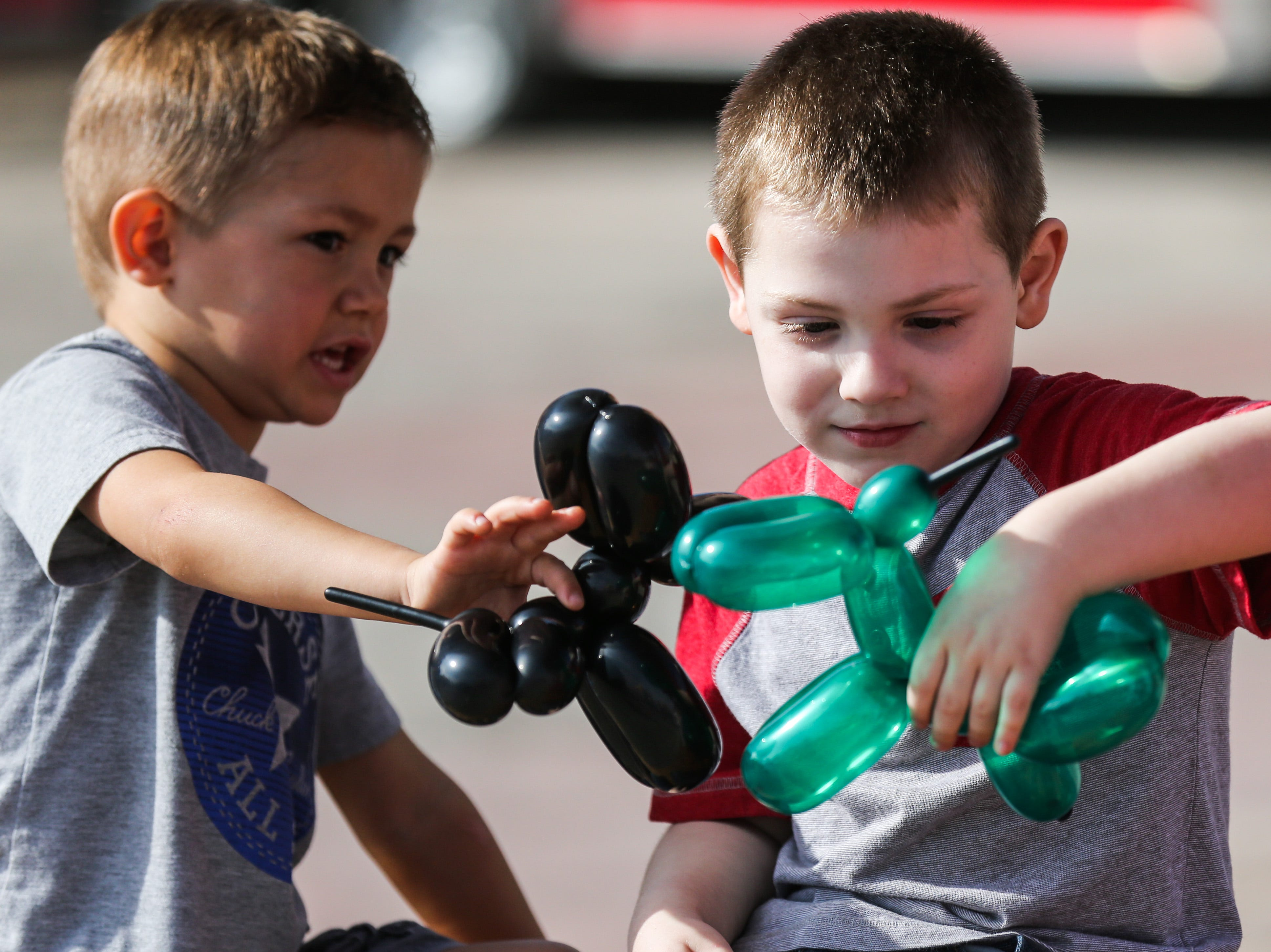 Jaxtyn Doggett and Daniel Guerra play with balloon animals during a field trip to the San Angelo Stock Show & Rodeo Tuesday, Feb. 5, 2019, at the San Angelo Fairgrounds.