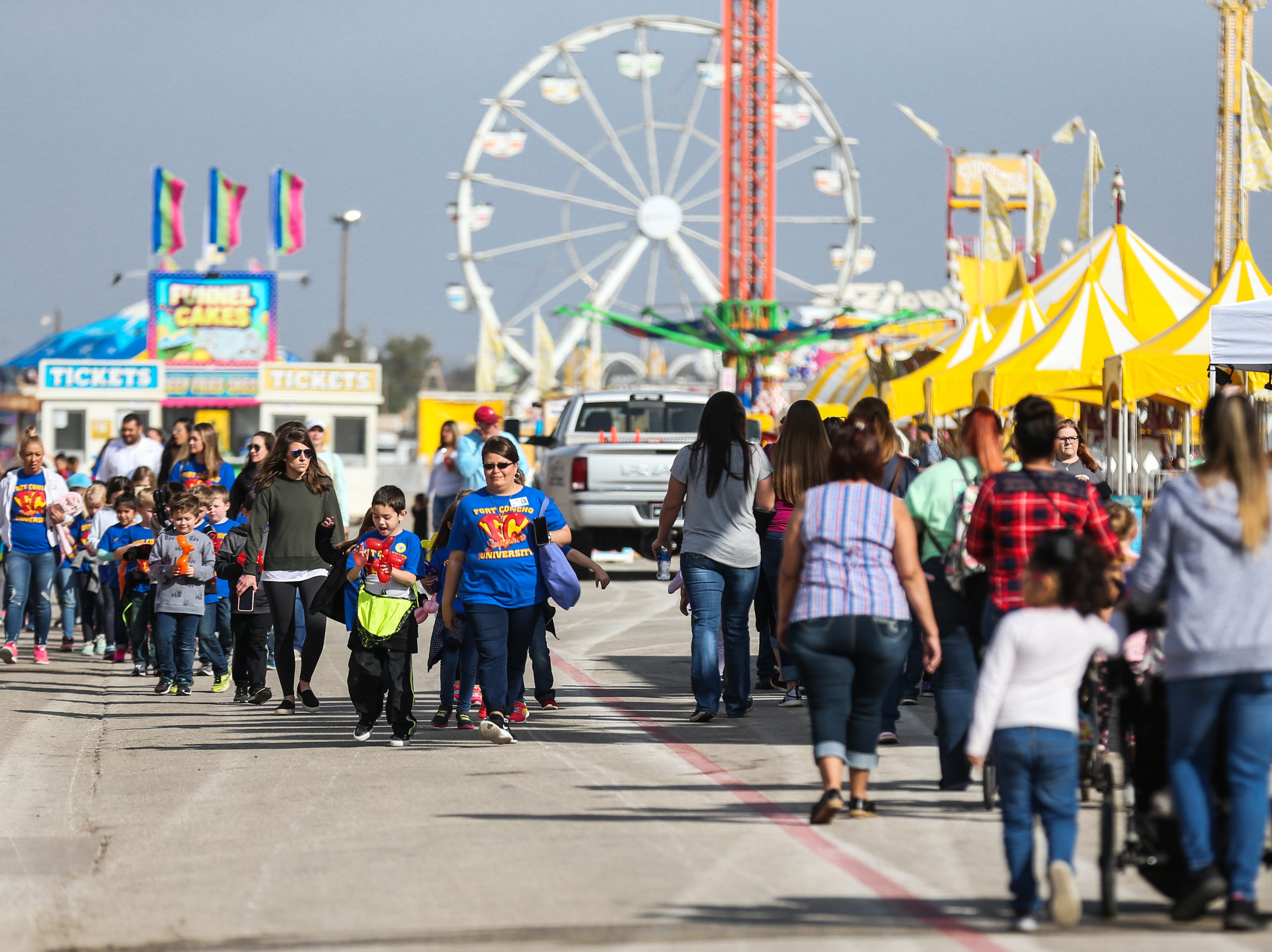 Attendees walk around the carnival grounds during the San Angelo Stock Show & Rodeo Tuesday, Feb. 5, 2019, at the San Angelo Fairgrounds.