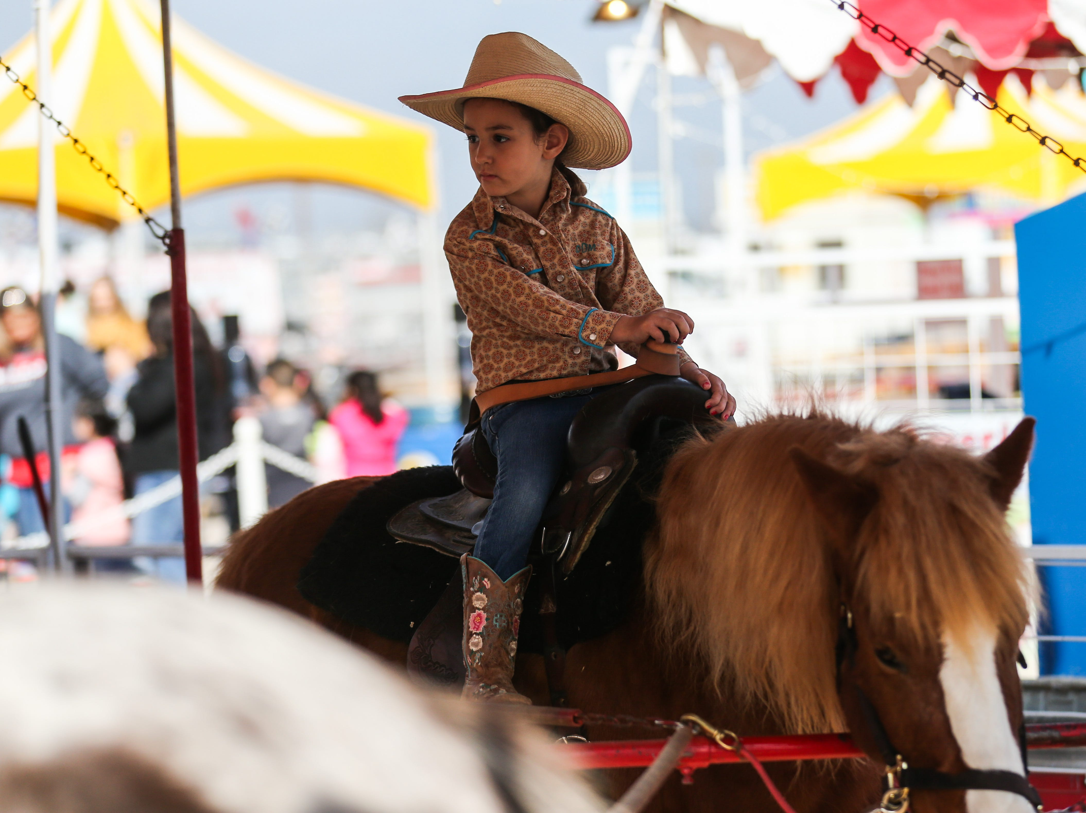 Davie Doyle, 4, from Granbury rides on a pony at the San Angelo Stock Show & Rodeo Tuesday, Feb. 5, 2019, at the San Angelo Fairgrounds.