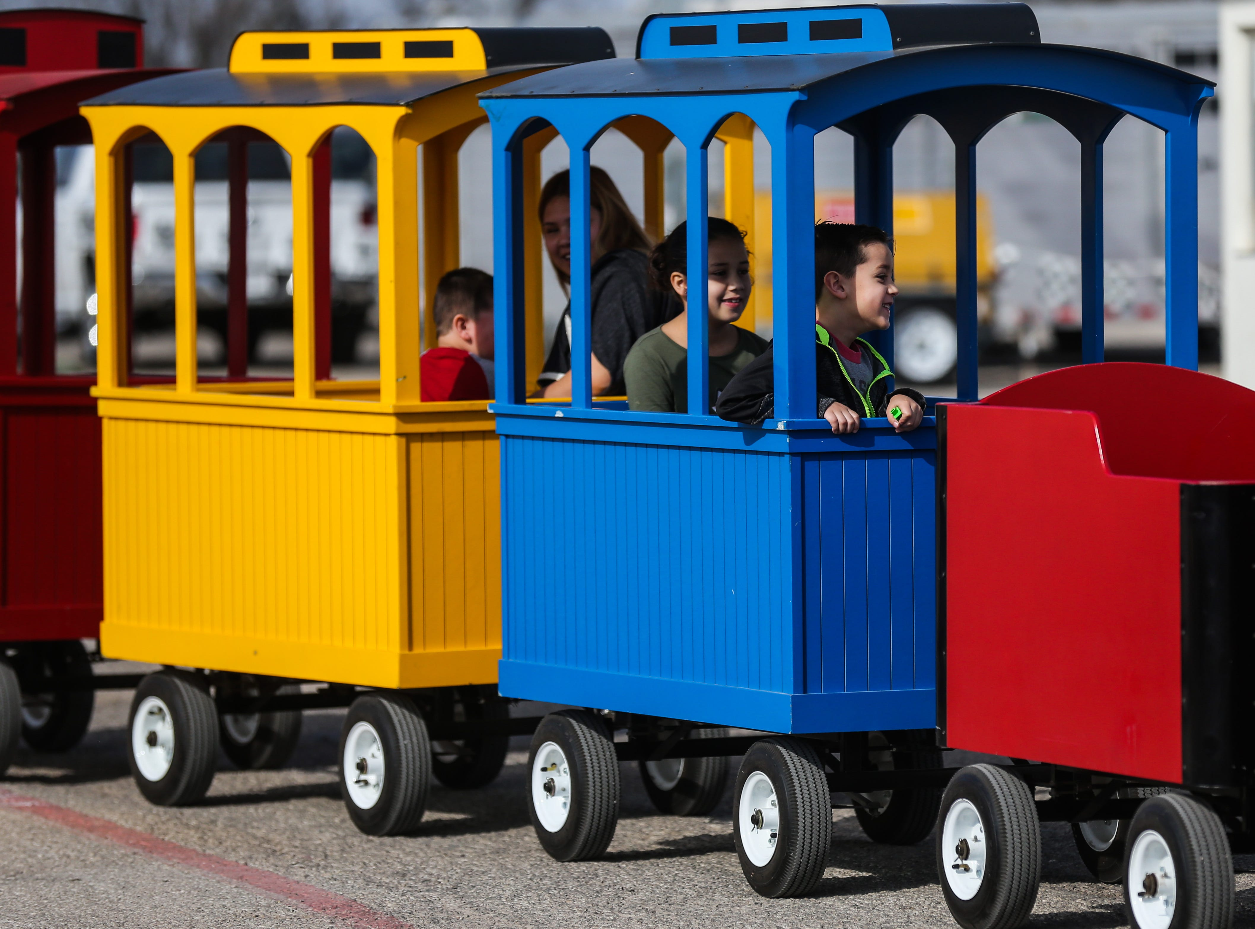 Students take a train ride during a field trip to the San Angelo Stock Show & Rodeo Tuesday, Feb. 5, 2019, at the San Angelo Fairgrounds.