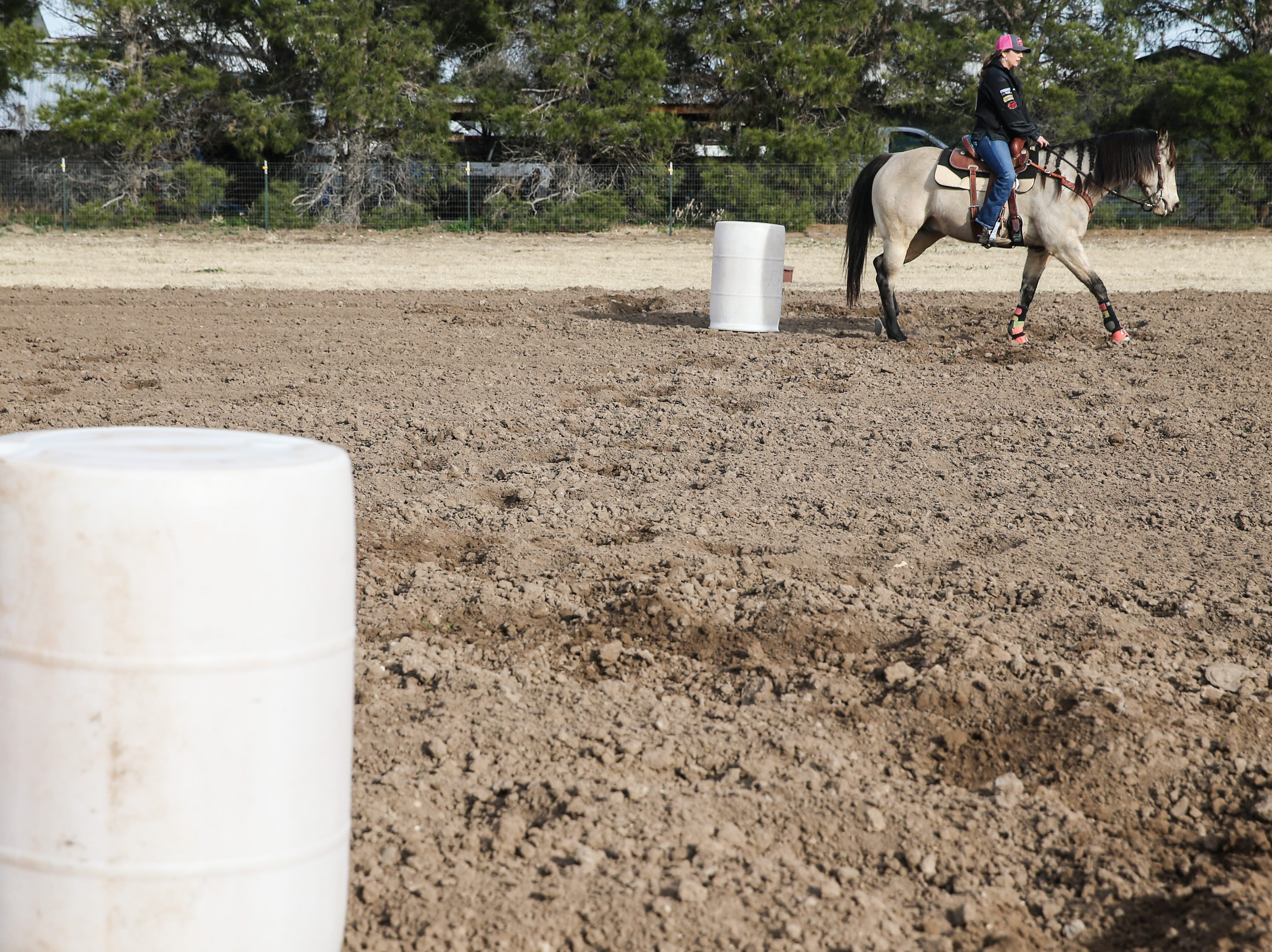 Bridget Carr practices the barrels on Corona Tuesday, Jan. 29, 2019, at home in San Angelo.