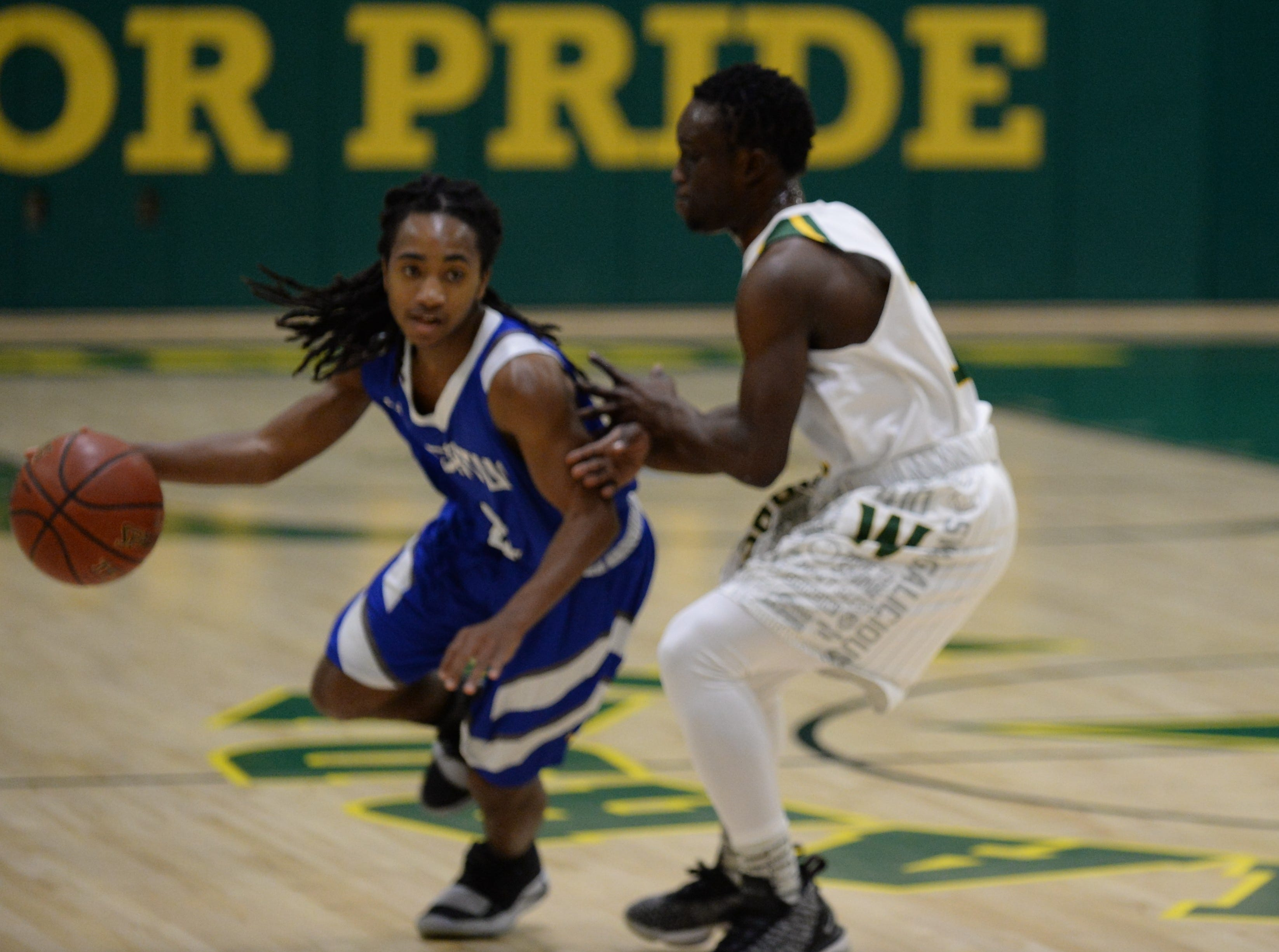 Stephen Decatur's Antonio Collins maneuvers around a Mardela defender on Tuesday, Feb. 5, 2019.