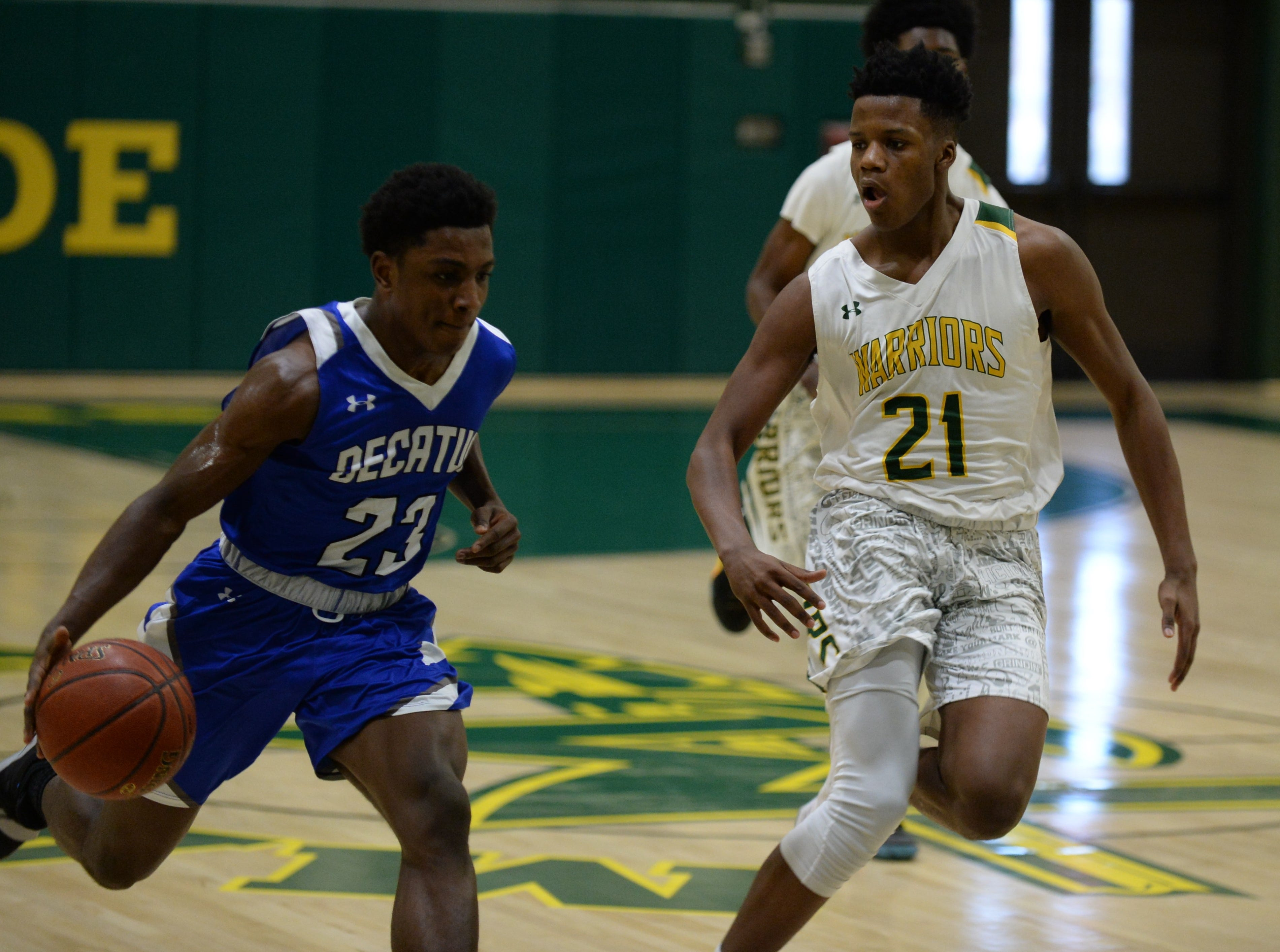 Stephen Decatur's London Drummond takes the ball past Mardela's Kyle Dickerson on Tuesday, Feb. 5, 2019.