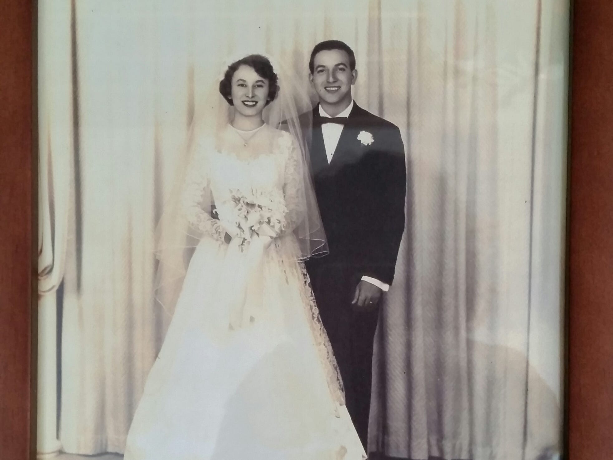 "Joe and Joann Bifano on their wedding day, Oct. 14, 1950 at St. John Evangelist Catholic Church in Kohler.  According to their daughter, Mary:  ""My dad was playing drums in a band for a private party at The Rathskellar, the basement of The Hoffbrau, now 8th Street Ale Haus. At the same time, my mom was attending a wedding shower upstairs of The Hoffbrau.   My dad ended up taking my mom and a girlfriend home. Her girlfriend had the hots for my dad and I believe went downstairs to talk to him and ask for a ride home. My dad, however, had his eyes on my mom, so he dropped off my mom's girlfriend first, leaving the two of them in the car together for a short amount of time. I guess enough time, for my dad to try to woo her into going on a date!"""