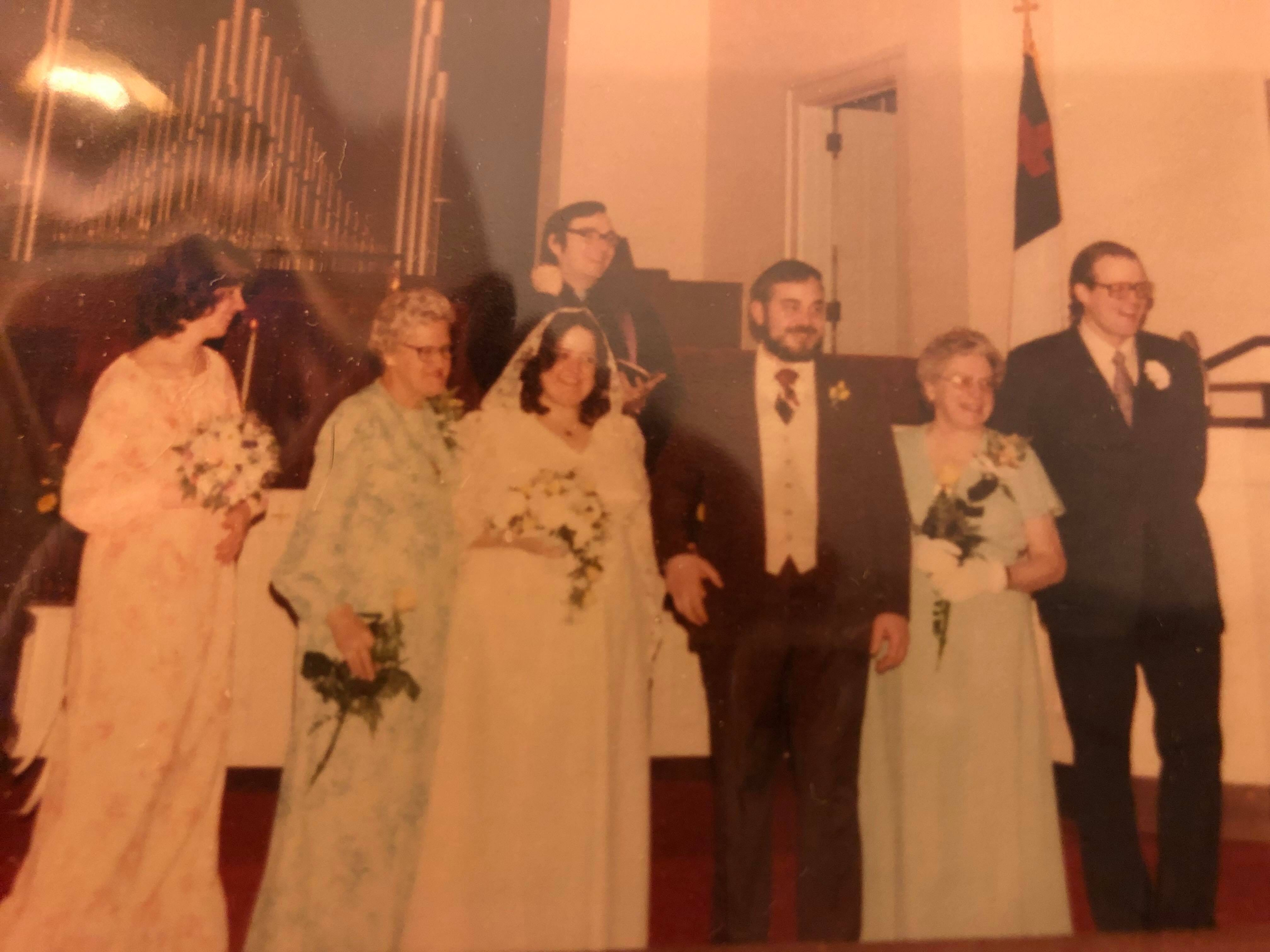 "Richard and Elinor (Hendee) Pool on  March 11th, 1978. They were married at Faith United Methodist Church in Sheboygan Falls, Wis.   From their daughter Samantha:  ""Both of my parents were volunteers at The Sheboygan Community Players (now known as The Sheboygan Theatre Company).   For the Christmas show in 1977 they were doing the show ""Babes in Toyland"" and after auditions they still needed a couple of main characters. My father was called and asked to play the role of Barnaby, the stereotypical bad guy figure (Black top-hat, Black cape, handlebar mustache) and my mother's as called and asked to play The Widow Piper (the female lead's mother).  On the first day of rehearsals (October 12th, 1977), my mother was running down the steps in the auditorium to the stage, tripped and fell, skidded across the stage and landed at my father's feet. That's how they met.   He likes to say she fell for him.   They started dating during rehearsals and by opening night, Dec. 1, 1977, they were engaged."""