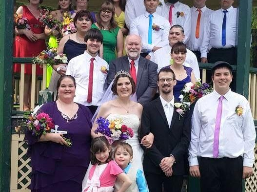 "Samantha James and husband Asher  James on their wedding day on June 20, 2015 at Lakeview Park in Sheboygan, Wis.  Samantha and Asher had a a rainbow themed wedding to show support for gay marriage as some of their closest friends were gay.  ""Everyone wore a different color and we had a drag queen and a lesbian in our wedding party,"" Samantha said.  The week of their honeymoon the gay marriage law was passed and the couple was overjoyed."