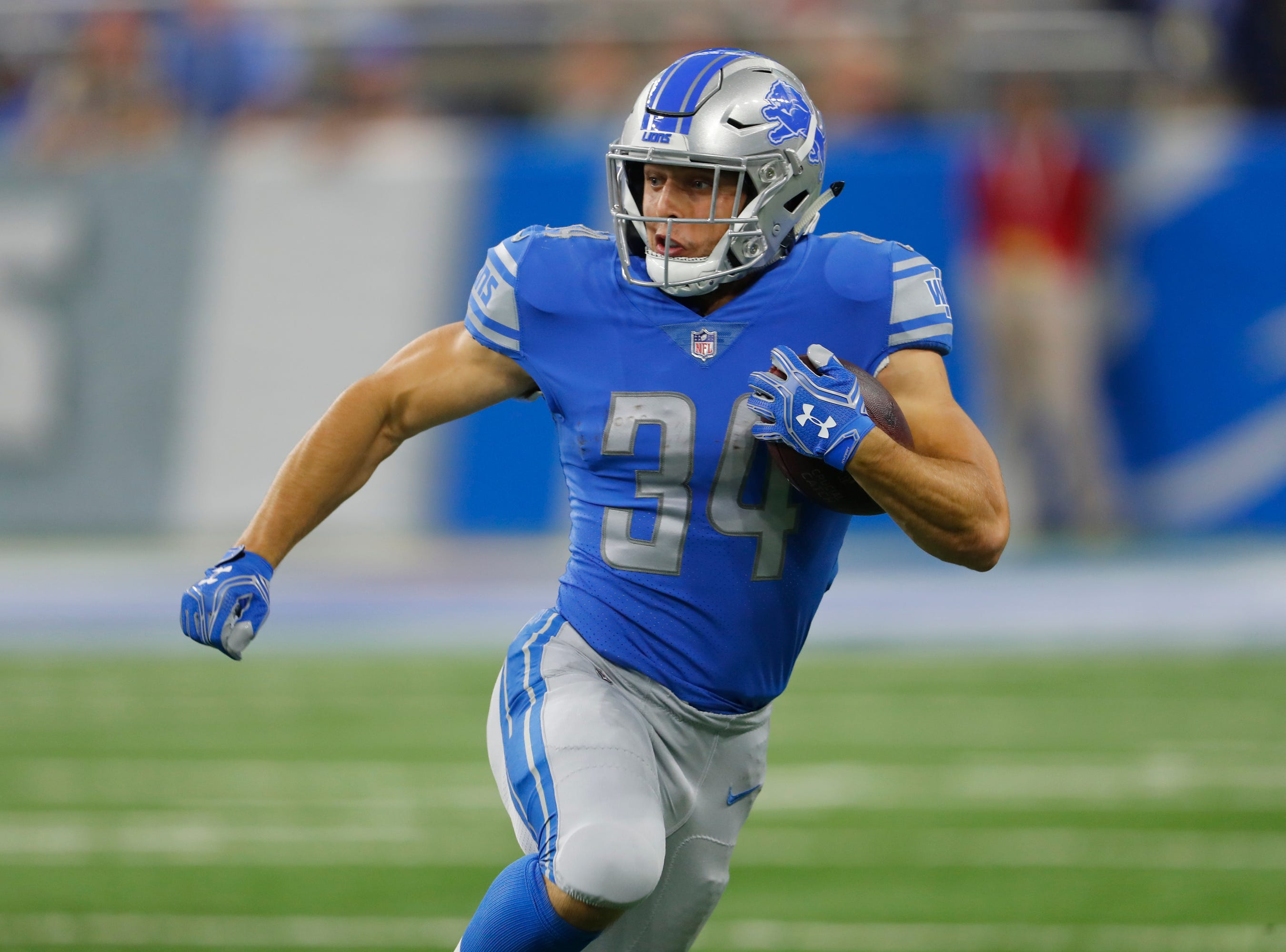 Detroit Lions running back Zach Zenner (34) runs against the Carolina Panthers during an NFL football game in Detroit, Sunday, Oct. 8, 2017. (AP Photo/Paul Sancya)