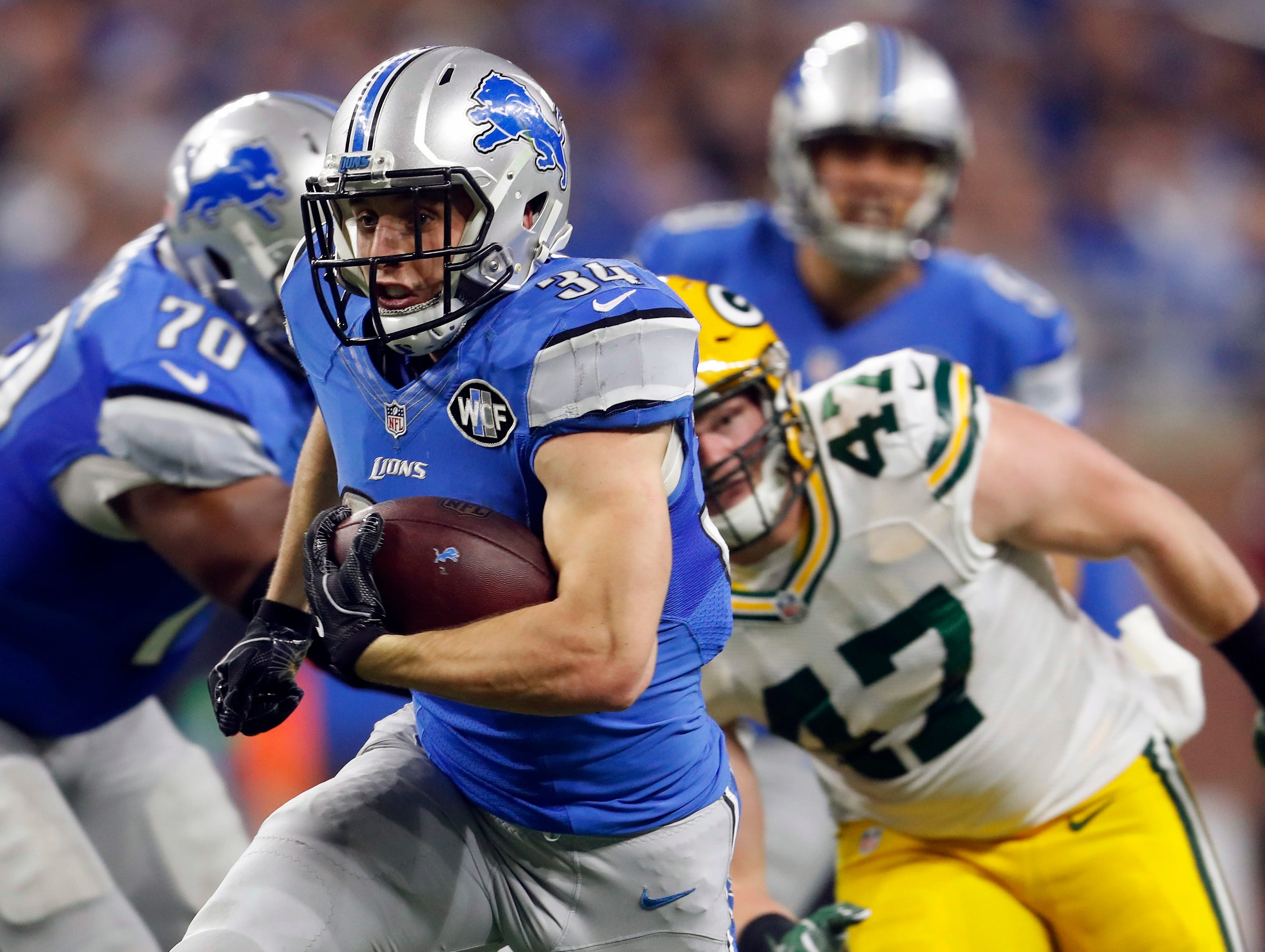 Detroit Lions fullback Zach Zenner rushes during the first half of an NFL football game against the Green Bay Packers, Sunday, Jan. 1, 2017, in Detroit. (AP Photo/Paul Sancya)