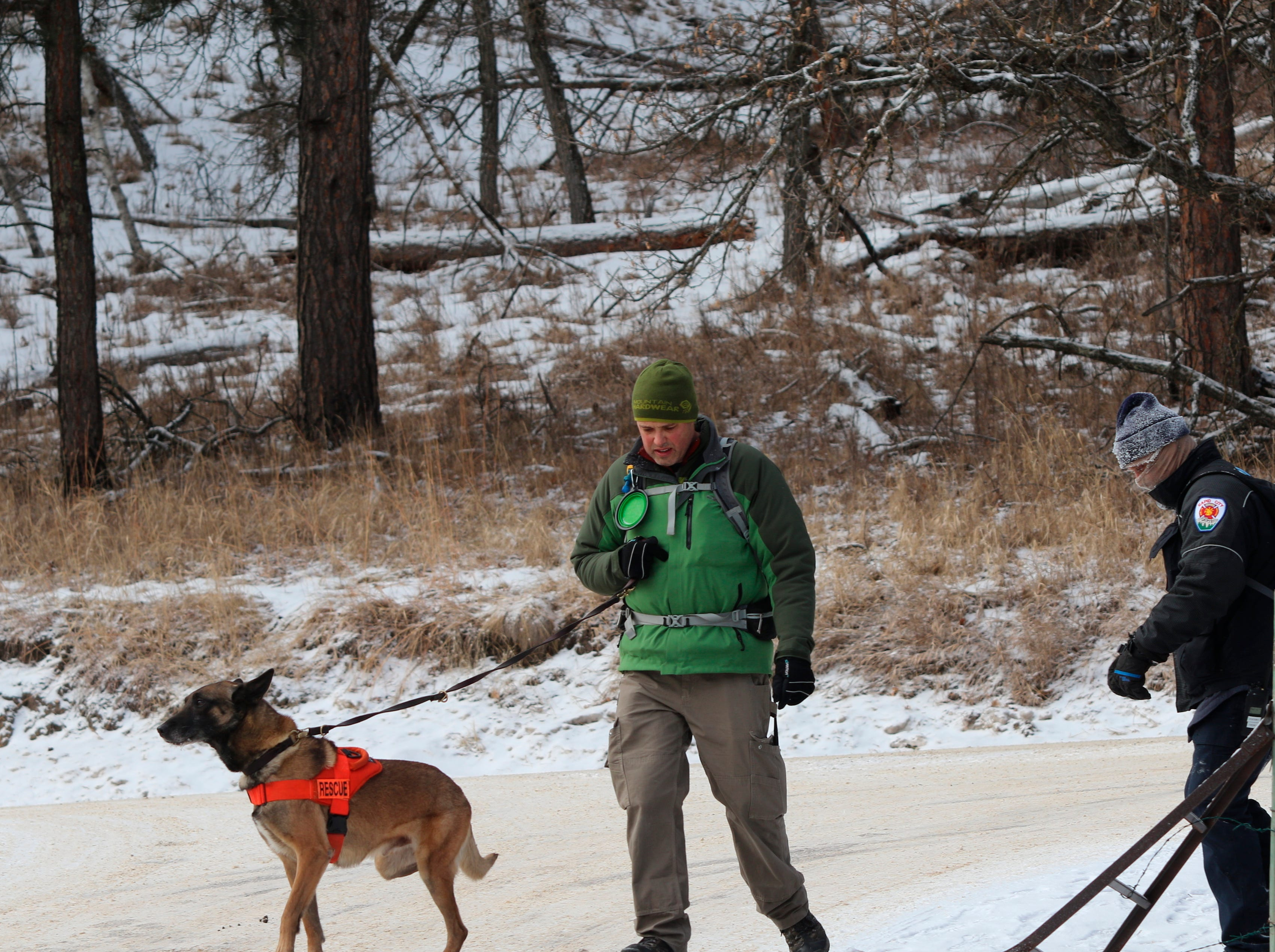 Cisco, a search-and-rescue dog with the Rapid City Fire Department, returns from searching for 9-year-old Serenity Dennard near Rockerville, S.D., Monday, Feb. 4, 2019. Authorities say that the girl ran away from staff at a residential youth home. (Arielle Zionts/Rapid City Journal via AP)