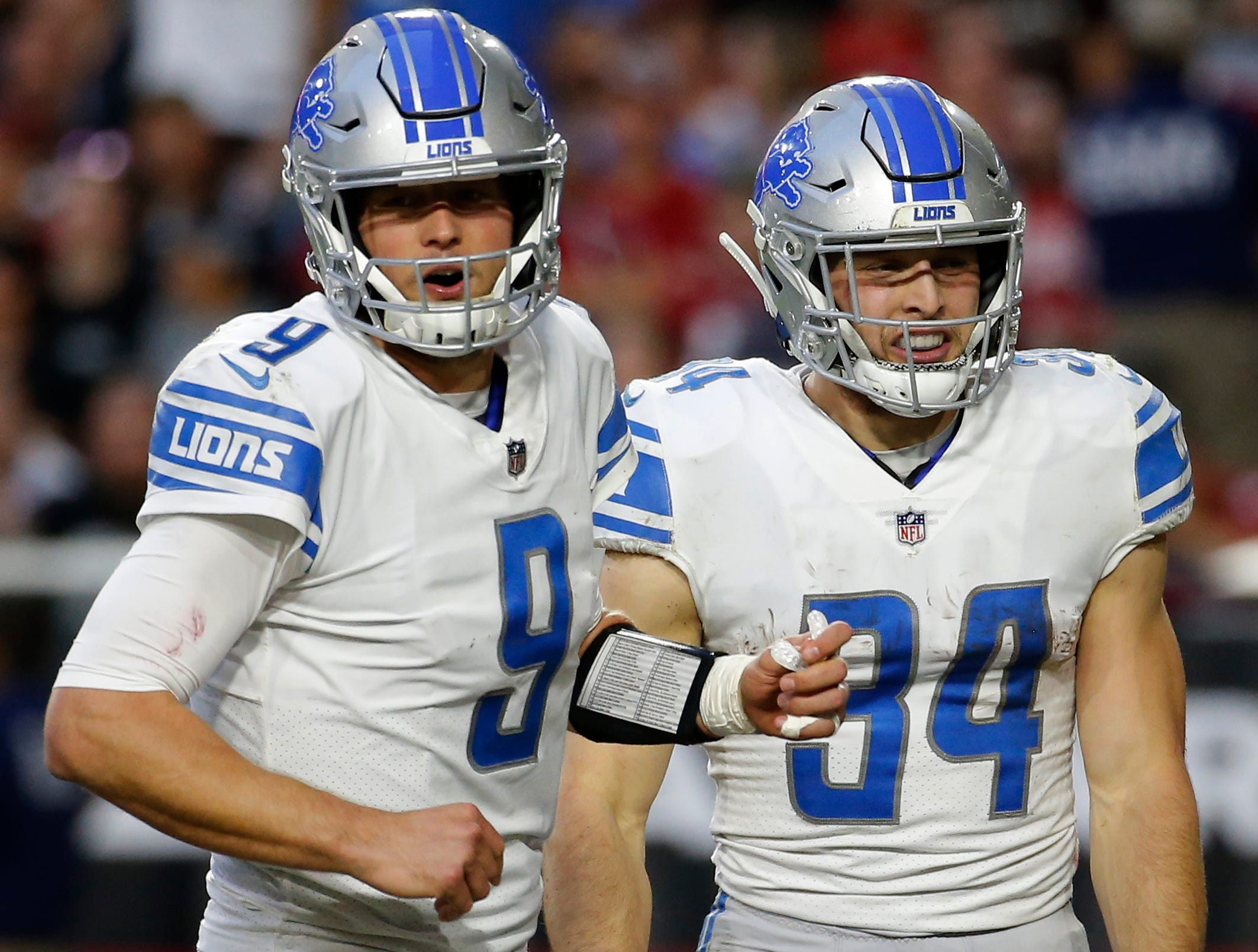 Detroit Lions running back Zach Zenner (34) celebrates his touchdown with quarterback Matthew Stafford (9) during the second half of NFL football game against the Arizona Cardinals, Sunday, Dec. 9, 2018, in Glendale, Ariz. (AP Photo/Rick Scuteri)