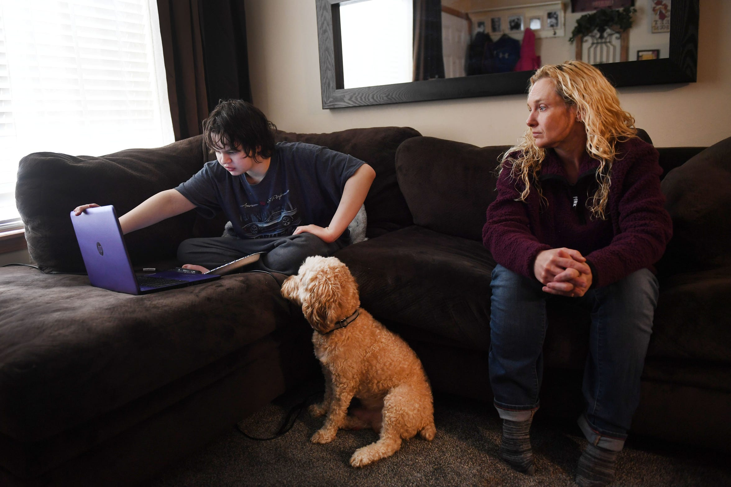 Nick Johnson talks about being home from the HSC, Human Services Center, a state psychiatric hospital in Yankton Tuesday, Feb. 5, with his mom Beverly Johnson at their home in Sioux Falls. Nick's dog, Jasper, hasn't left Nick's side since he got home. Nick has been battling several mental health issues for the past couple of years. Beverly Johnson, Nick's mom, advocates for better children's mental health in the state.