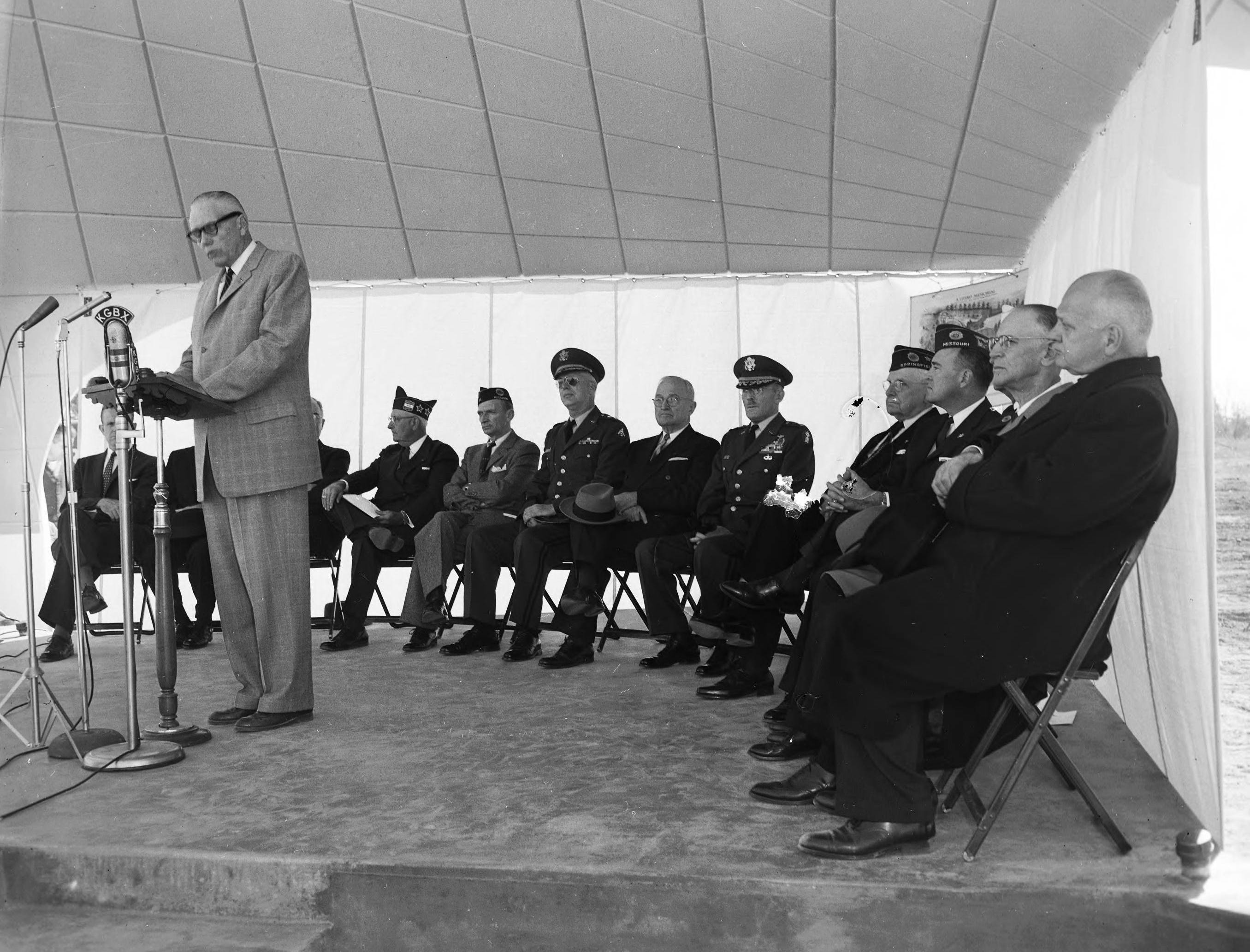 C.E. Baxter, a retired military man , introduced former President Harry S. Truman at the ceremonies dedicating the Living Memorial on Highway 65. The memorial was a long-planned effort of the War Dads. Similar photograph published in the Leader & Press on November 11, 1958.