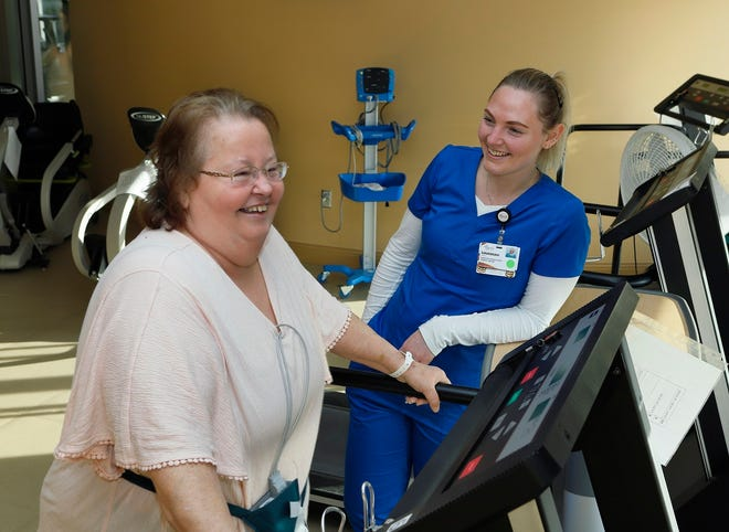 Diana Amick with exercise physiologist Savannah Young at Augusta Health's cardiac rehab in Fishersville.