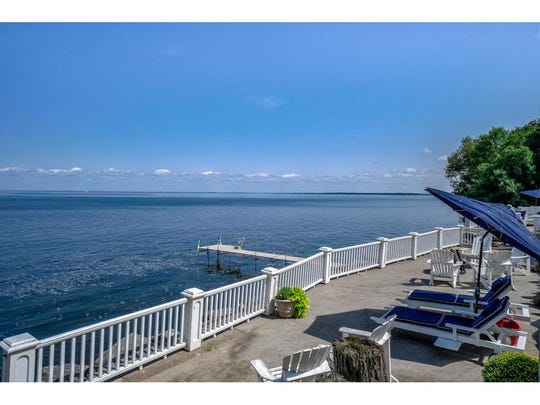 Much of the property's shoreline is rimmed by a long patio sitting above the rock wall and overlooking the lake.