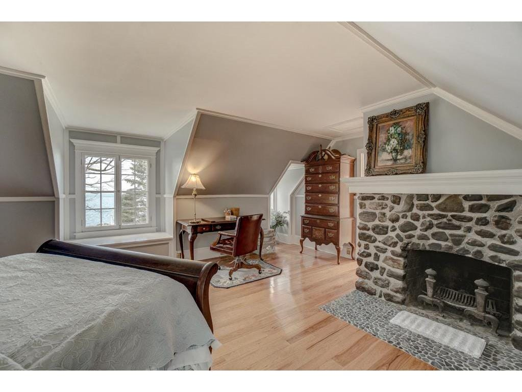 The master suite boasts its own fireplace, a beautiful cedar closet, an exercise room and a massive master bath.