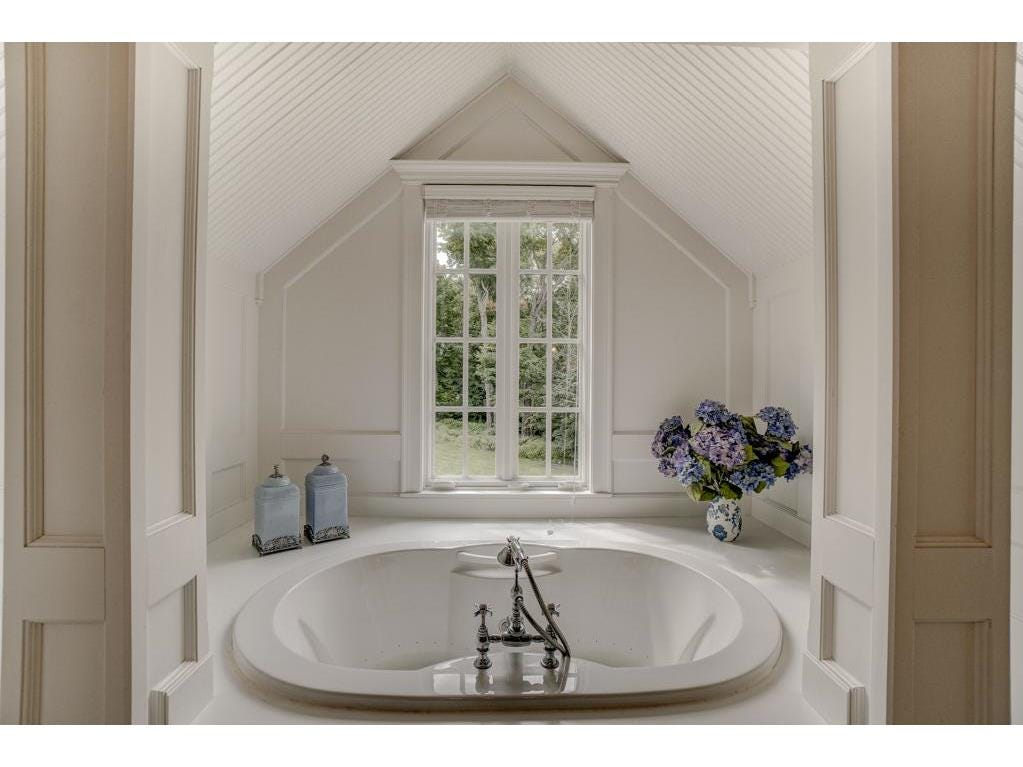 The master bath features a glass shower and a whirlpool nestled into its own cozy upstairs nook.
