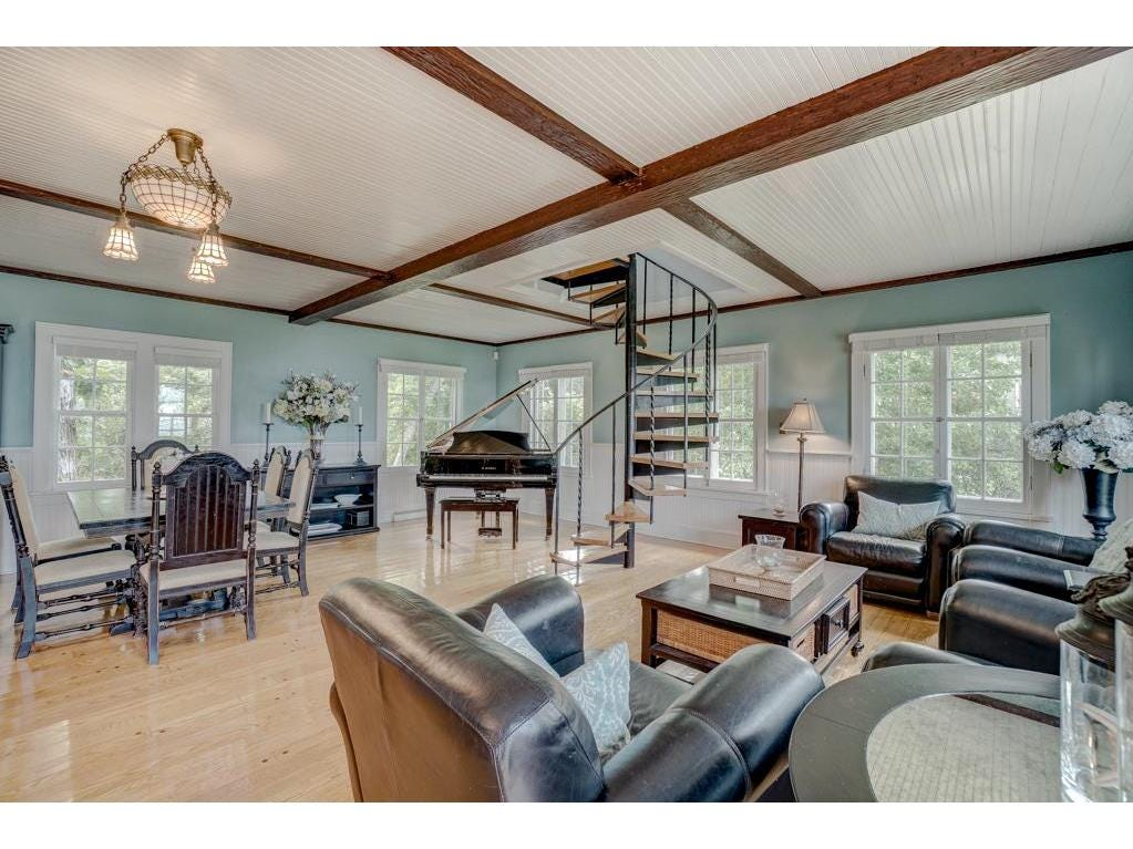 The main floor of the home features a central area comprised of a spacious living and dining area.