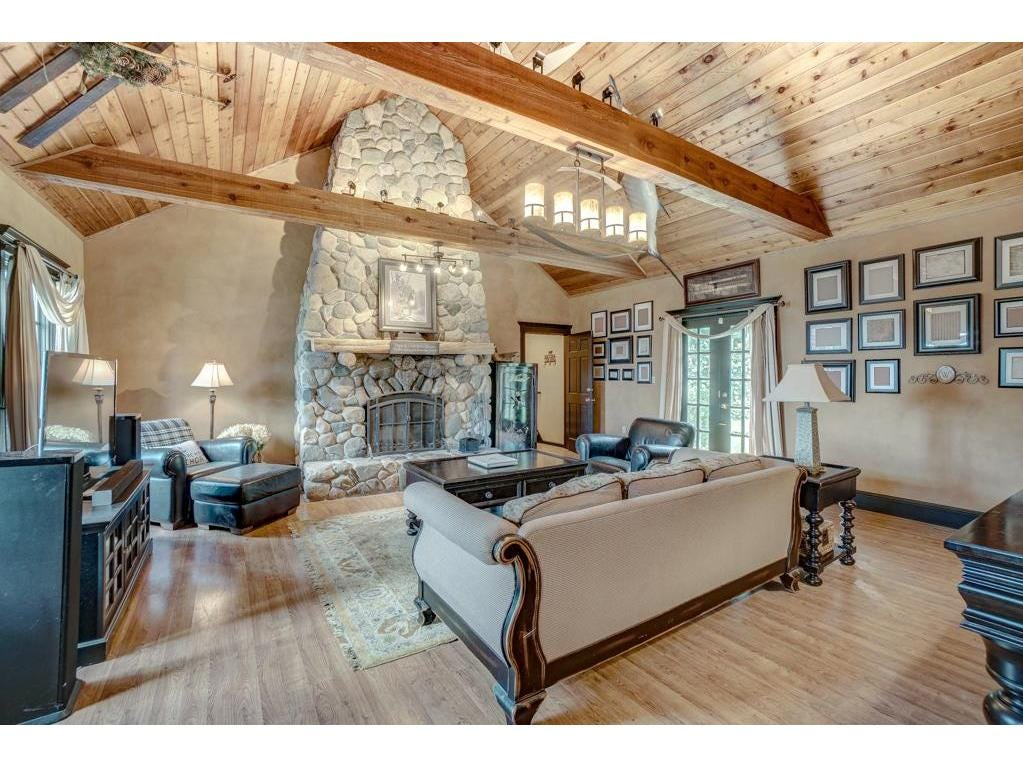 The main level also has a two-story family room with a massive stone fireplace stretching the height of both stories.