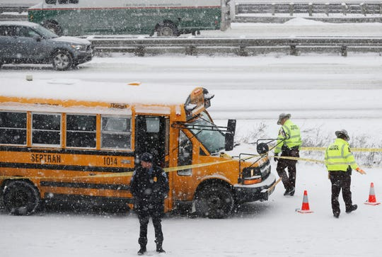 A person of interest was taken into custody after a school bus driver was shot where Interstate 35W and 94 run together near downtown Minneapolis Tuesday, Feb. 5. (Richard Tsong-Taatarii/Star Tribune via AP)