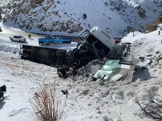 A semi truck hit a Utah Highway Patrol vehicle as it slid off the roadway and crashed into a hillside in the Laketown Canyon on state Route 30, according to the UHP. Both the deputy and driver of the semi were injured, although the injuries were not believed to be life-threatening.