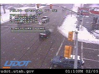 A traffic camera above Main Street in Cedar City catches vehicles traversing snowy conditions on Tuesday as a winter storm rolled into the area.