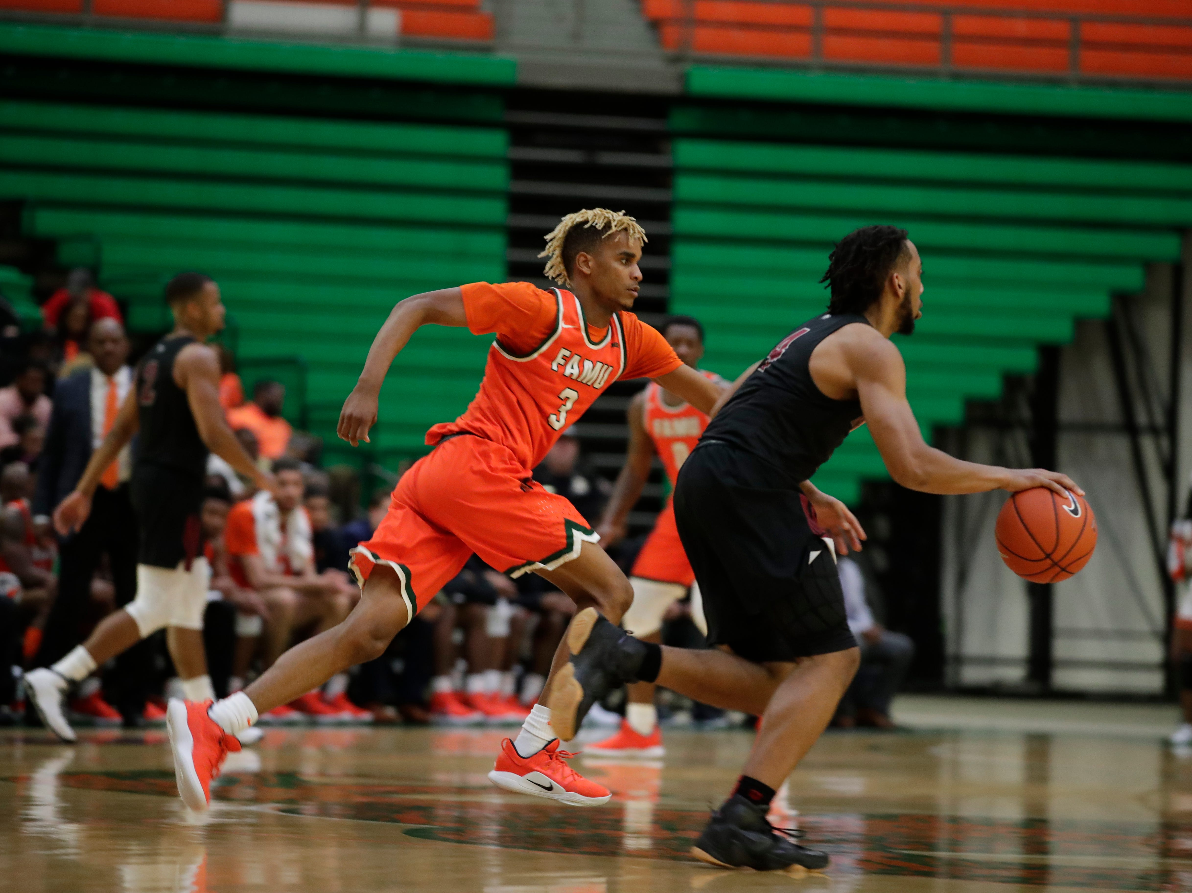 FAMU guard MJ Randolph (3) runs to catch up to his man at the Alfred Lawson Jr. Multipurpose Center Monday, Feb. 4, 2019. The Rattlers defeated N.C. Central.
