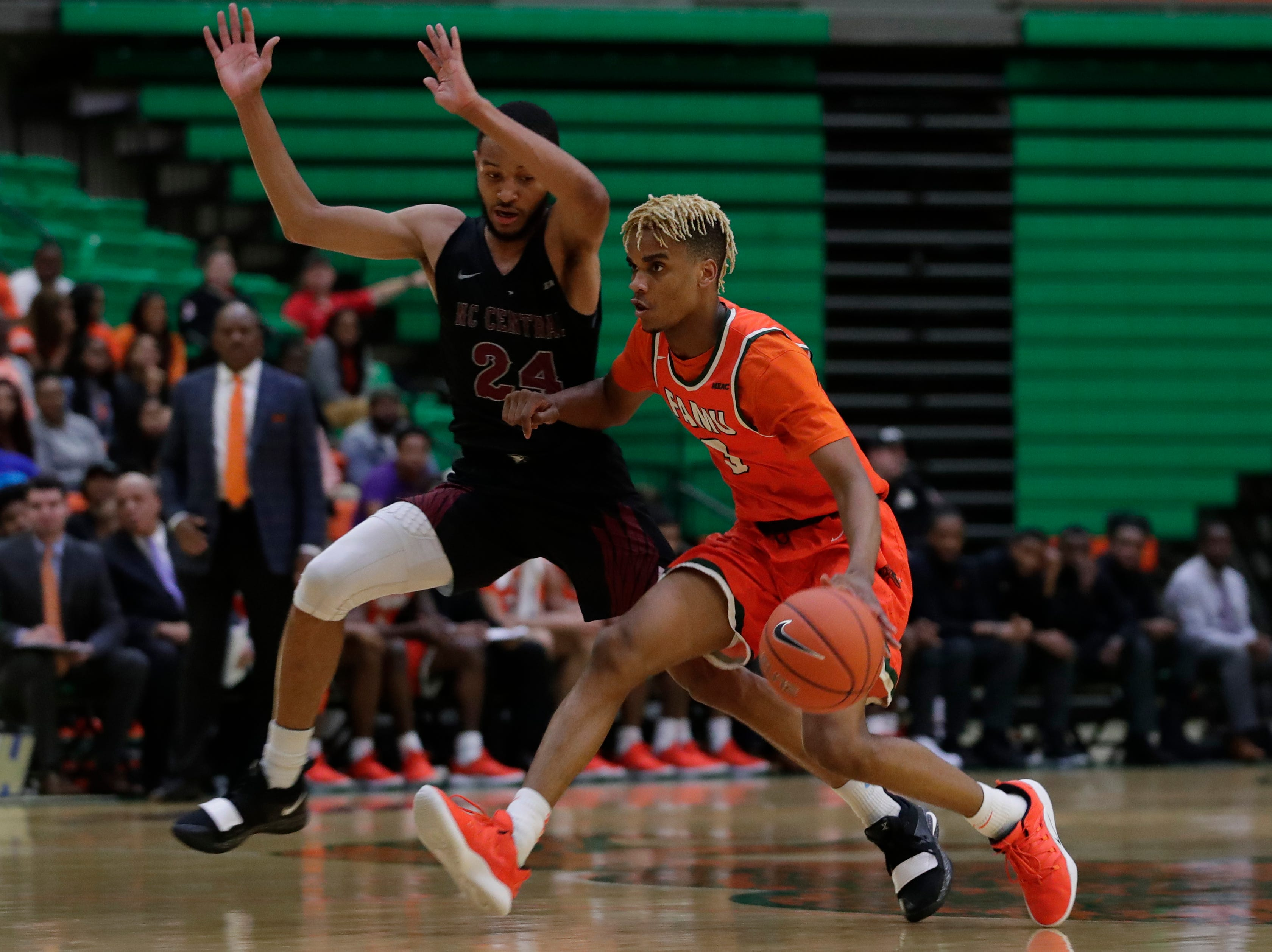 Florida A&M Rattlers guard MJ Randolph (3) dribbles past a defender during a game between FAMU and North Carolina Central at the Alfred Lawson Jr. Multipurpose Center Monday, Feb. 4, 2019.