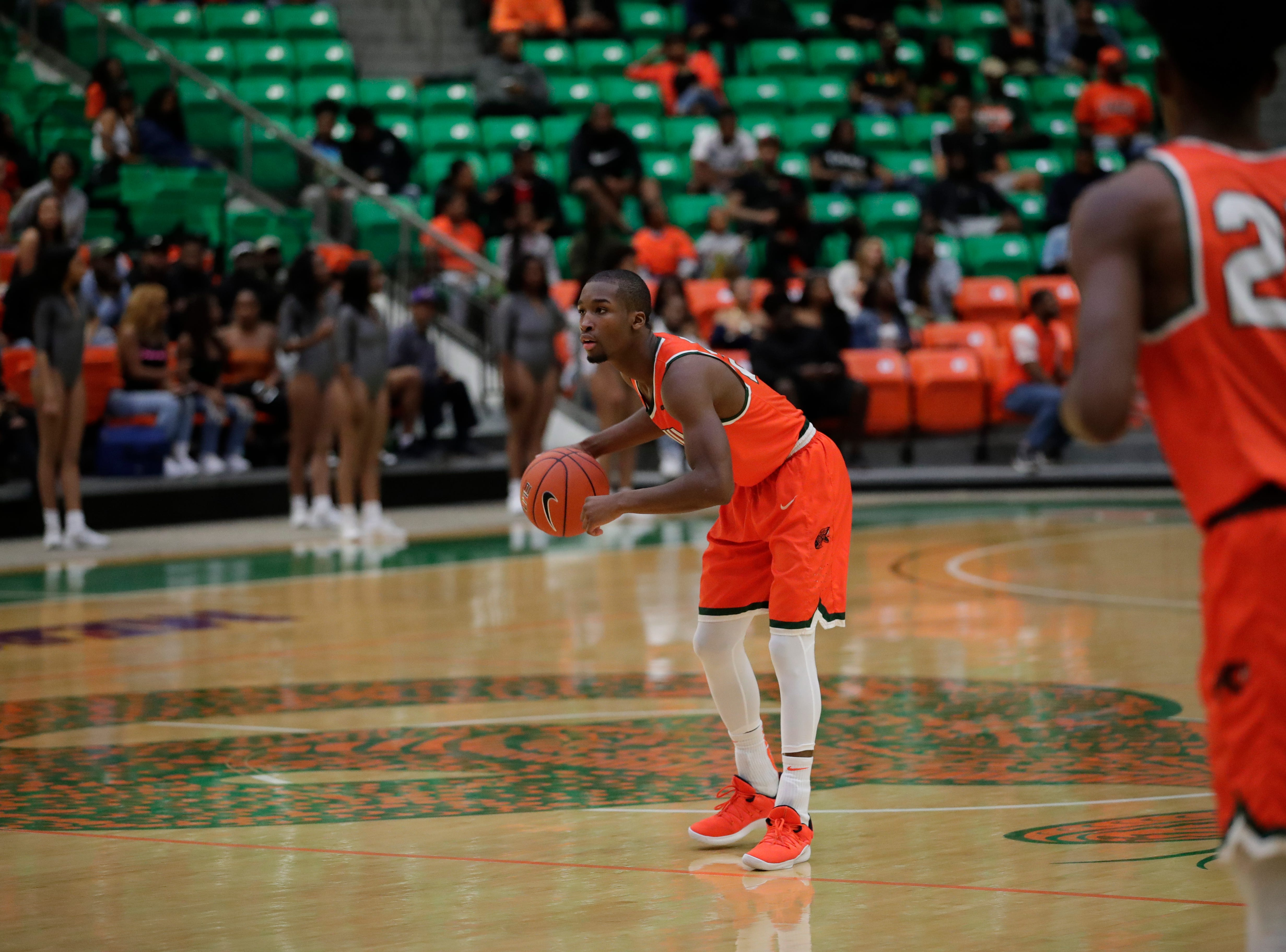 Florida A&M Rattlers guard Justin Ravenel (21) waits to set up a play during a game between FAMU and North Carolina Central at the Alfred Lawson Jr. Multipurpose Center Monday, Feb. 4, 2019.