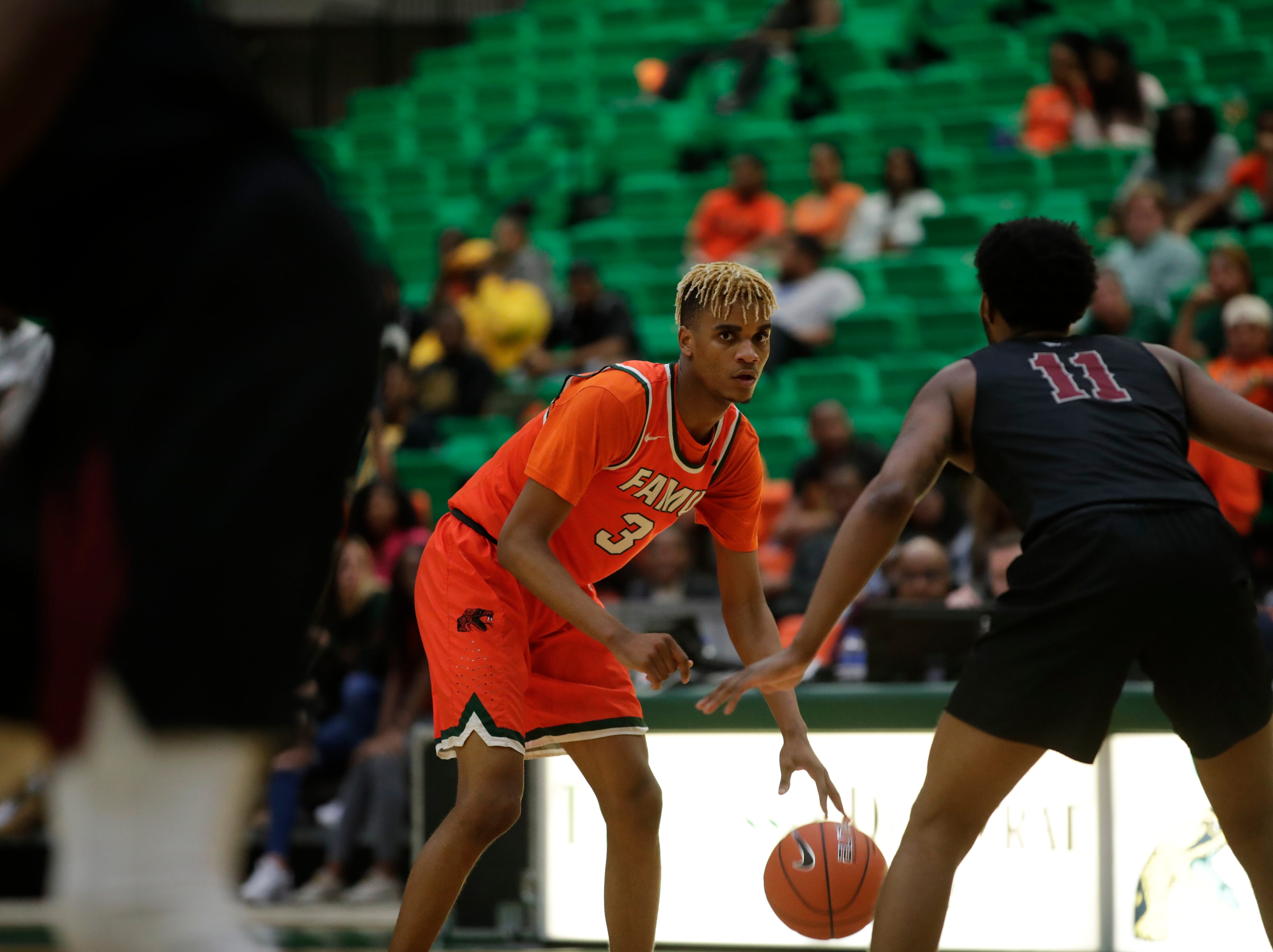 FAMU's M.J. Randolph sizes up N.C. Central's Randy Miller at the Alfred Lawson Jr. Multipurpose Center Monday, Feb. 4, 2019.