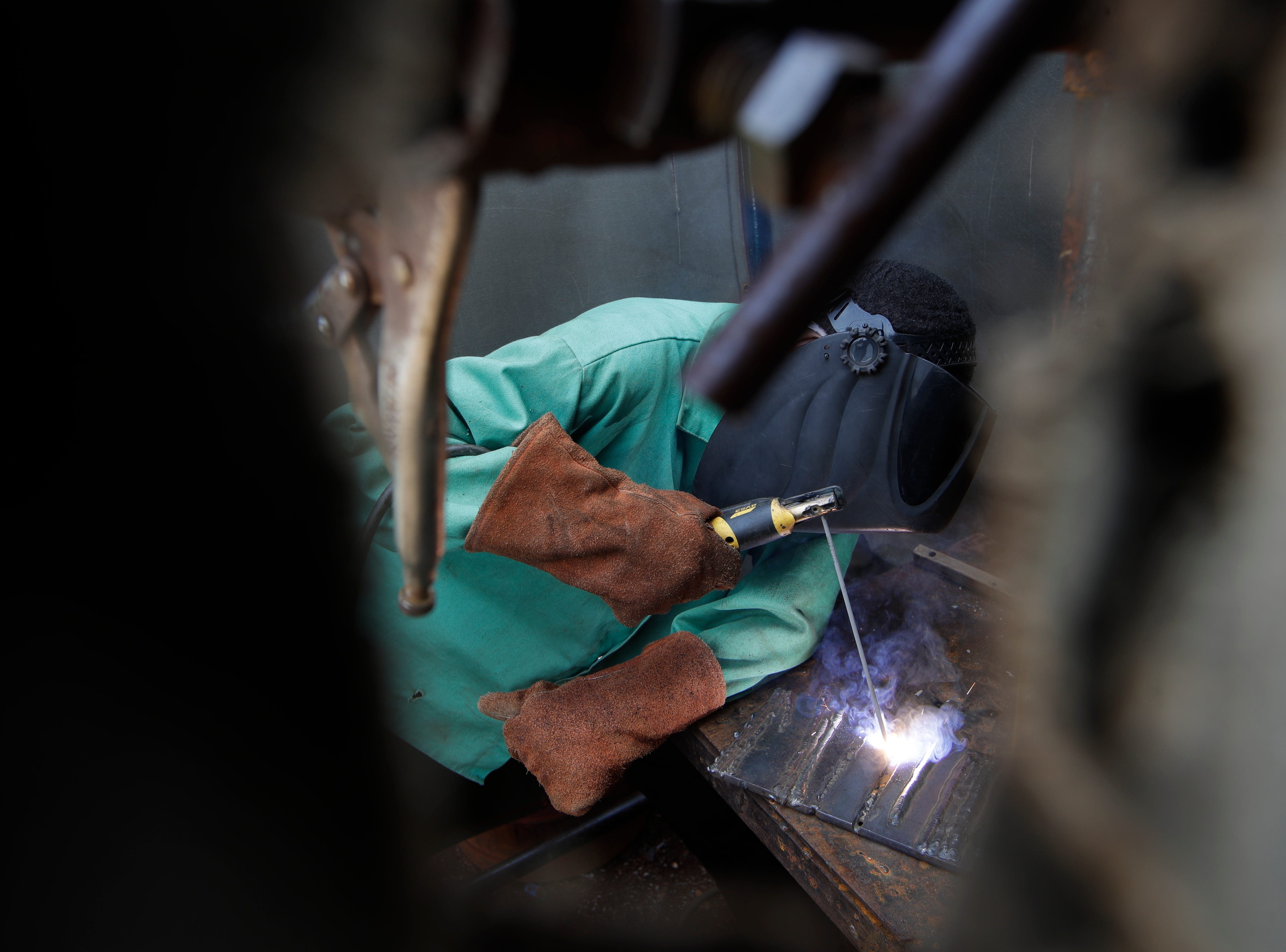 Clarence Lovett, 15, a Godby High School student, practices welding during class Tuesday, Feb. 5, 2019.
