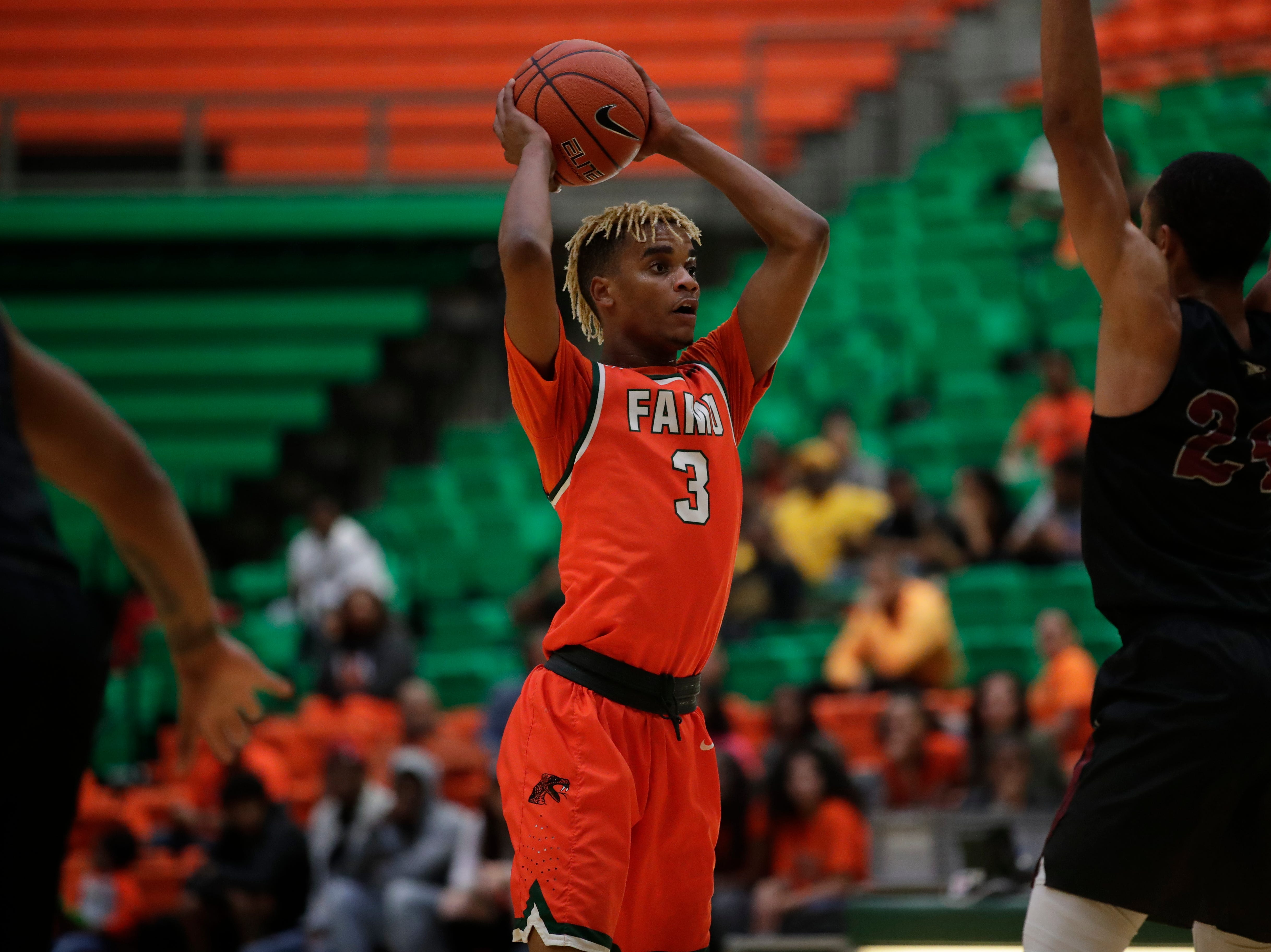 Florida A&M Rattlers guard MJ Randolph (3) looks for an open man during a game between FAMU and North Carolina Central at the Alfred Lawson Jr. Multipurpose Center Monday, Feb. 4, 2019.