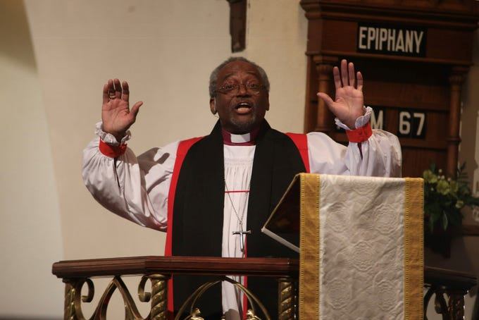 Presiding Bishop Michael Bruce Curry preaches from the pulpit to a packed house at St. John's Episcopal Church service Monday, Feb. 4, 2019.