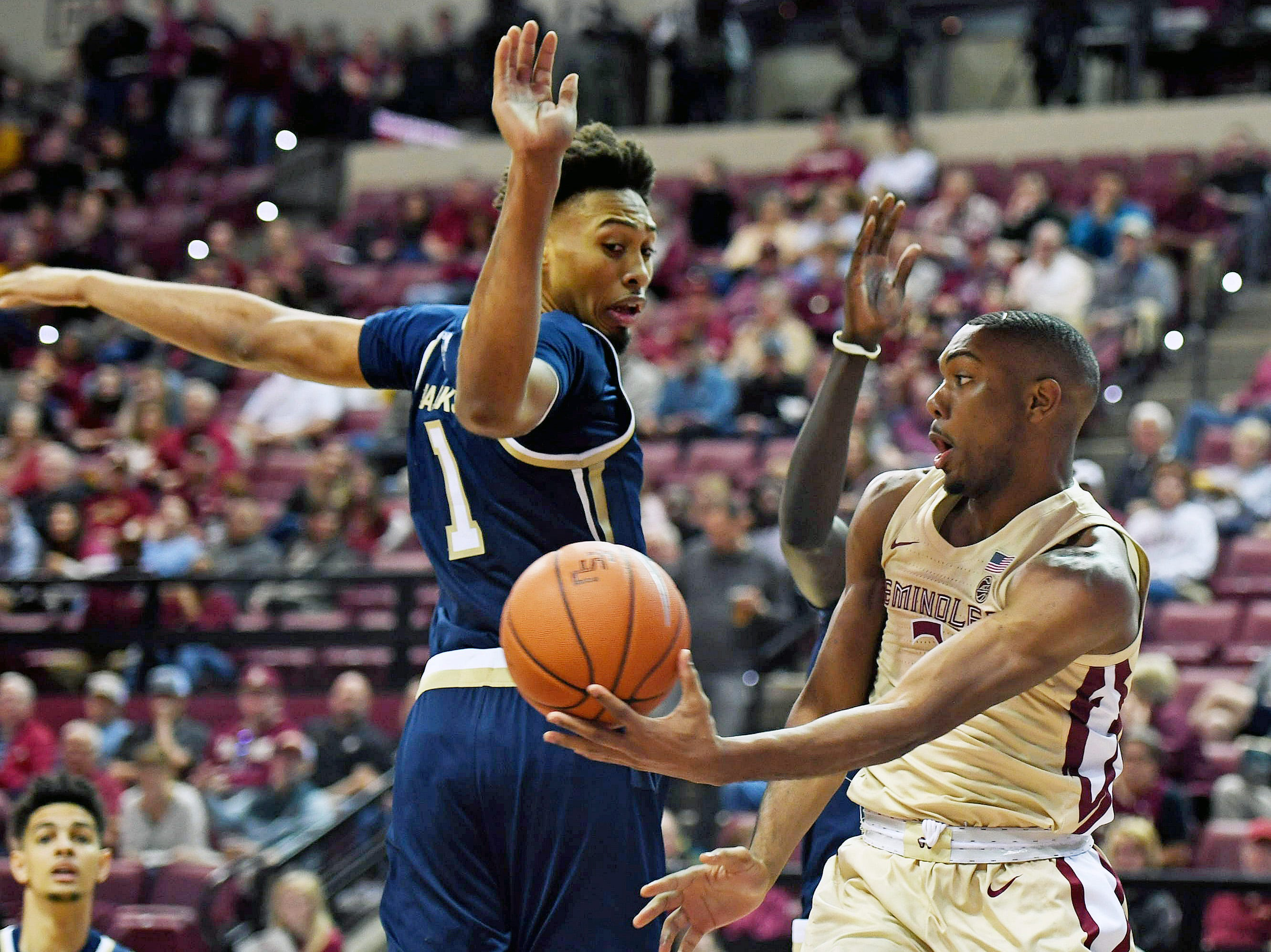 Feb 2, 2019; Tallahassee, FL, USA; Florida State Seminoles guard Trent Forrest (3) passes the ball around Georgia Tech Yellow Jackets forward James Banks III (1) during the first half at Donald L. Tucker Center. Mandatory Credit: Melina Myers-USA TODAY Sports