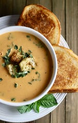 The ultimate comfort food: roasted tomato soup and a grilled cheese.