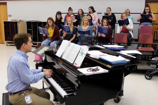 "Chiles choral director, Corey Sullivan, rehearses ""Lux Aeterna"" with his soprano section."