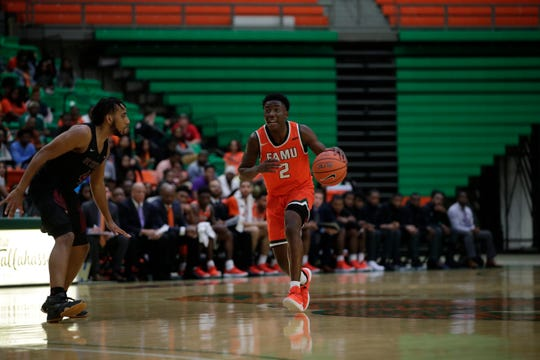 Florida A&M guard Kamron Reaves brings the ball up the court in a win over North Carolina Central at the Alfred Lawson Jr. Multipurpose Center Monday, Feb. 4, 2019.