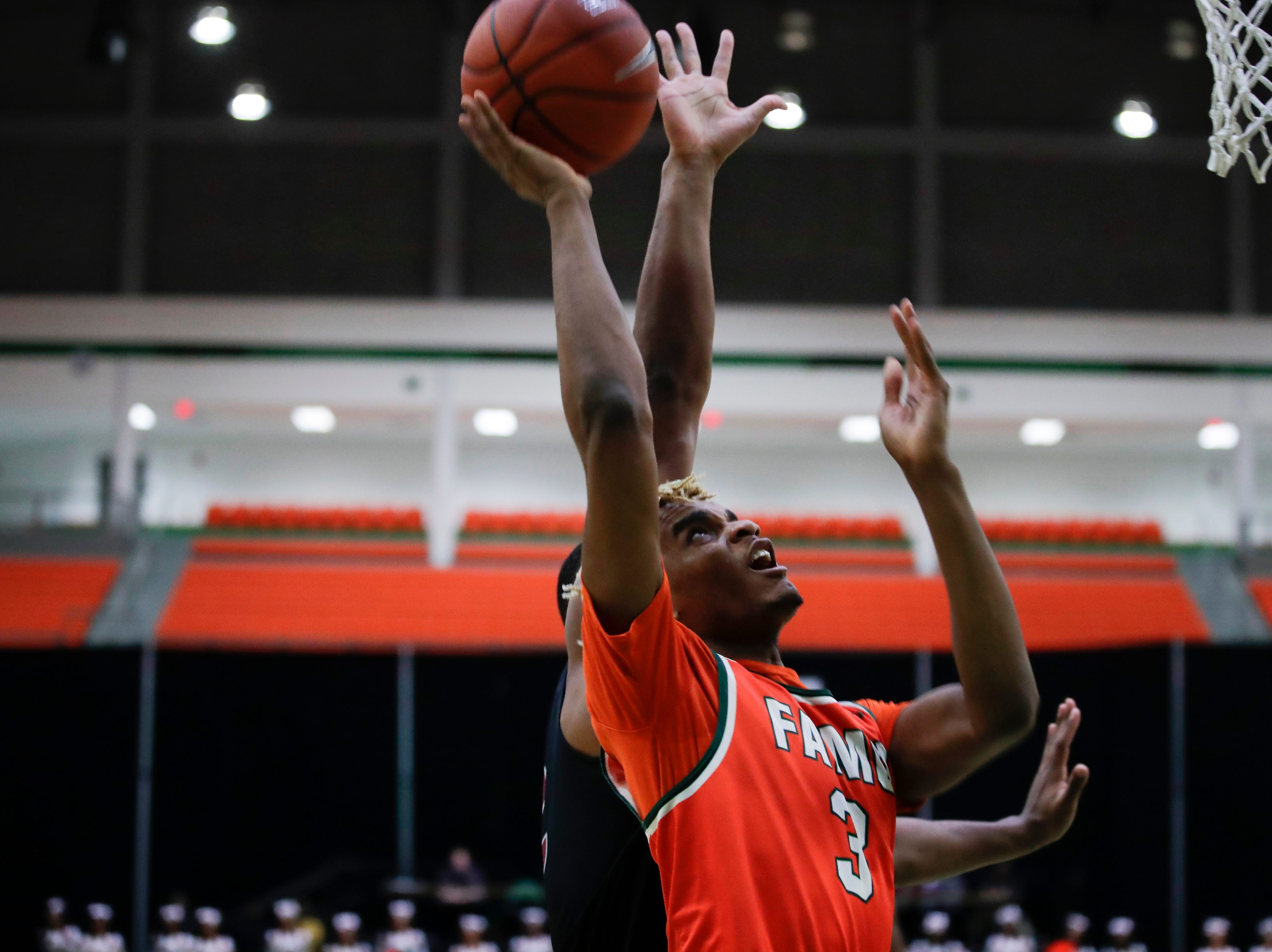 Florida A&M Rattlers guard M.J. Randolph puts up a shot during a game versus North Carolina Central at the Alfred Lawson Jr. Multipurpose Center Monday, Feb. 4, 2019.